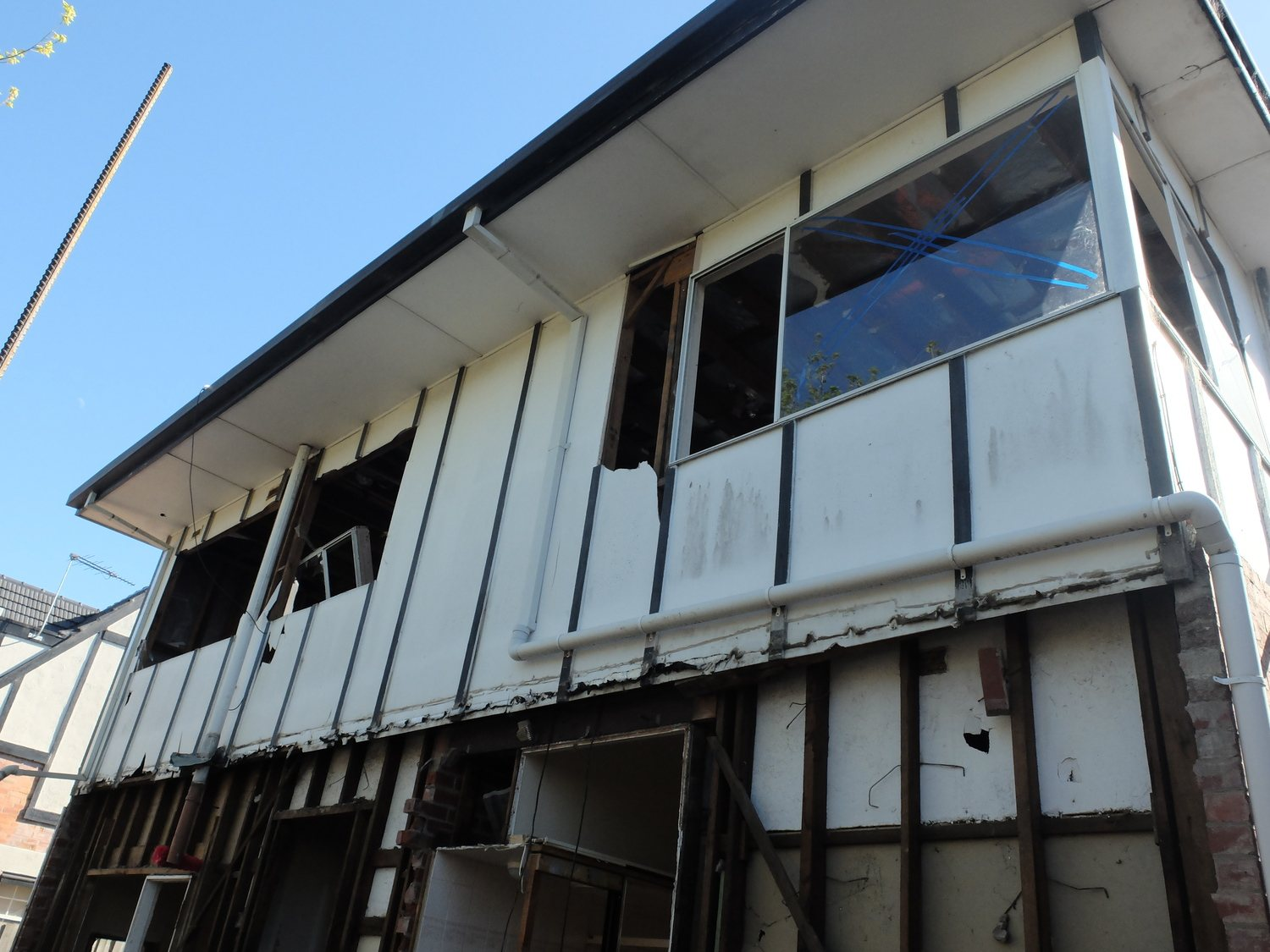 Asbestos testing Melbourne  - Both the upper walls and the eaves of this residence are made of asbestos cement sheeting. If you are part way through a demolition like this, it is better late than never - have your site tested for asbestos before going any further.