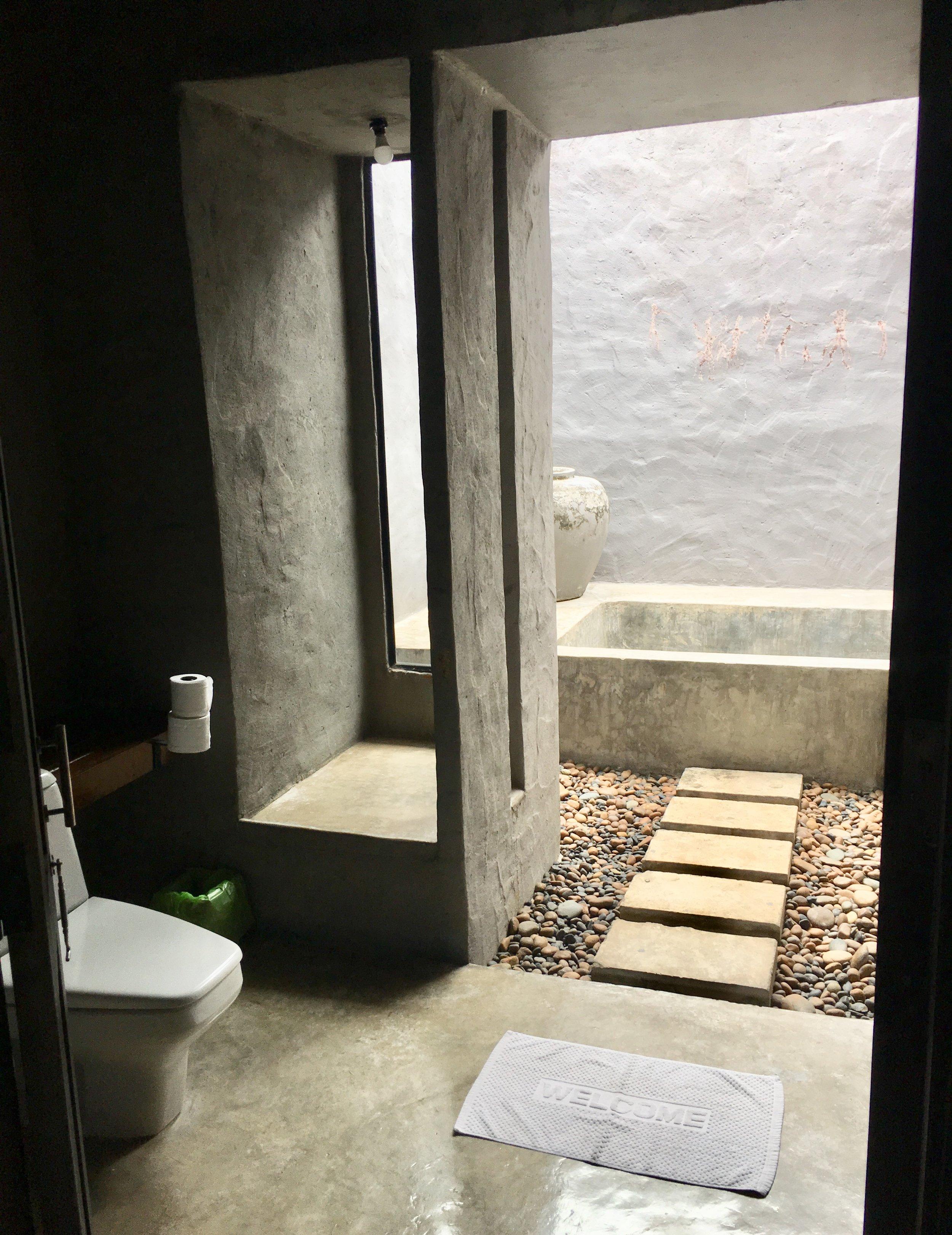 Neat indoor / outdoor bathroom and shower