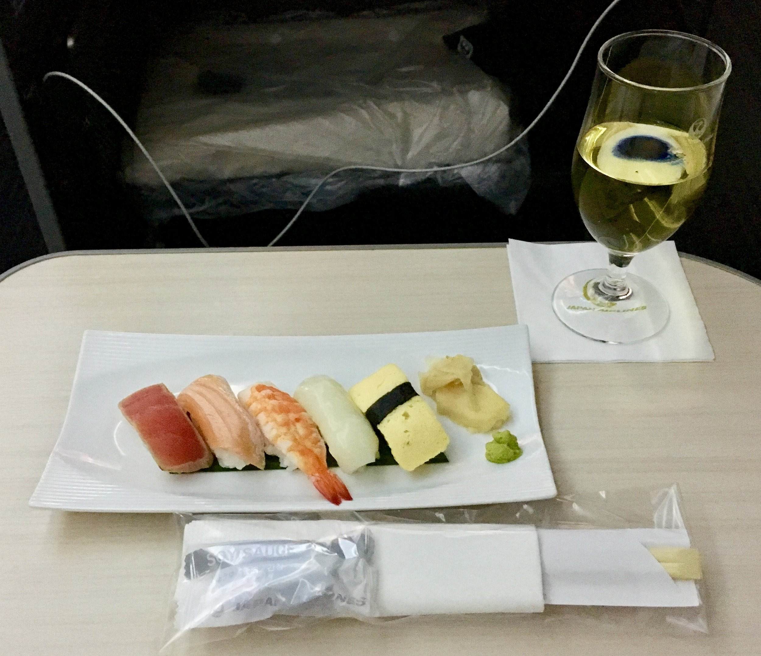 Sushi and/or nuts was served about 30 minutes after take-off, the full extent of any food offered on the flight before breakfast. I maximized what I could with the addition of some okay Charles Heidsieck champagne.