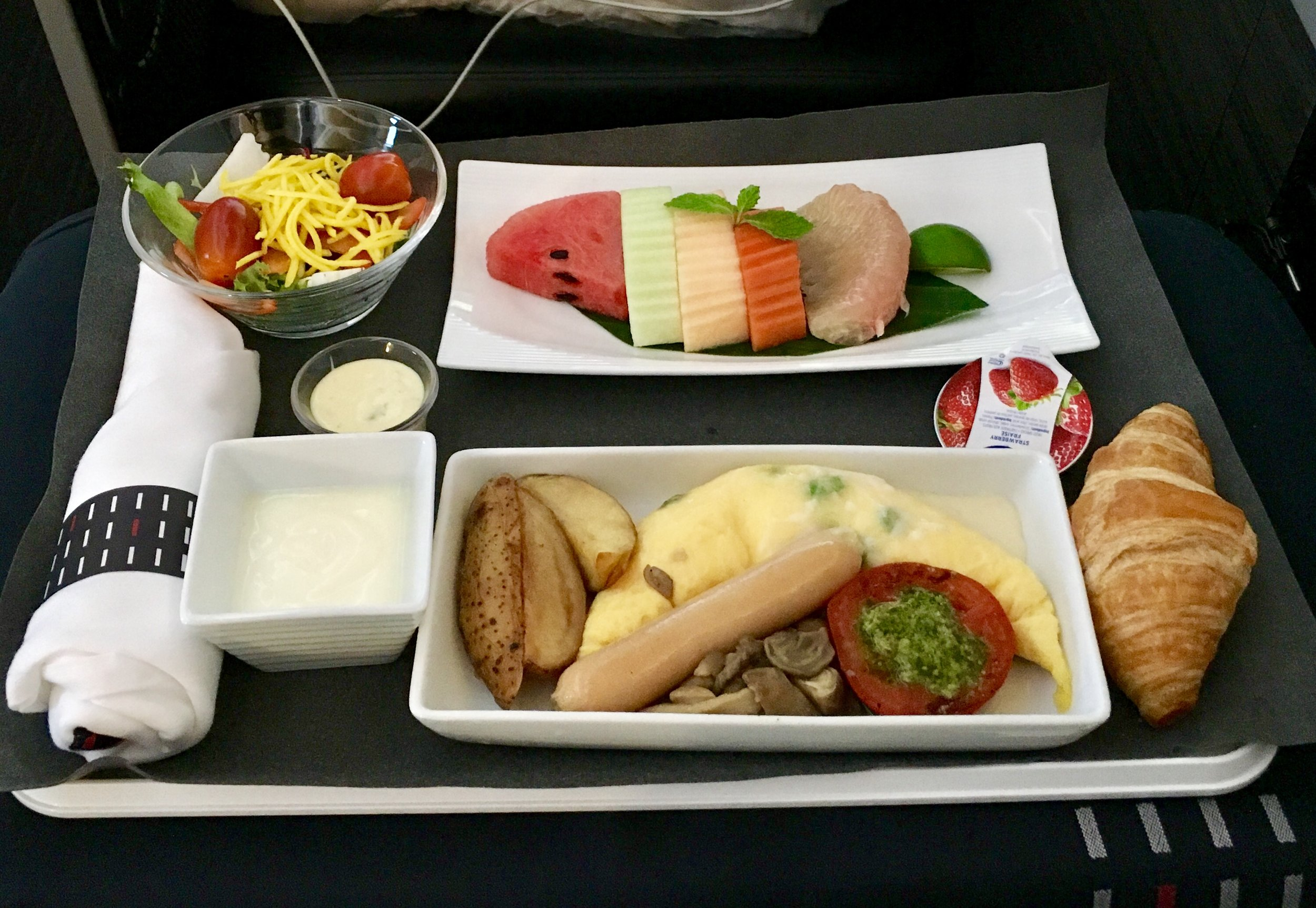 "The breakfast was BAAAD. The salad was fine but the rest…yikes. Tasteless fruit, lukewarm eggs with nasty sausage, a croissant still a bit frozen in the middle. It's like they tried to make stereotypical ""bad plane food"". Very disappointing, especially in business, and especially on JAL."