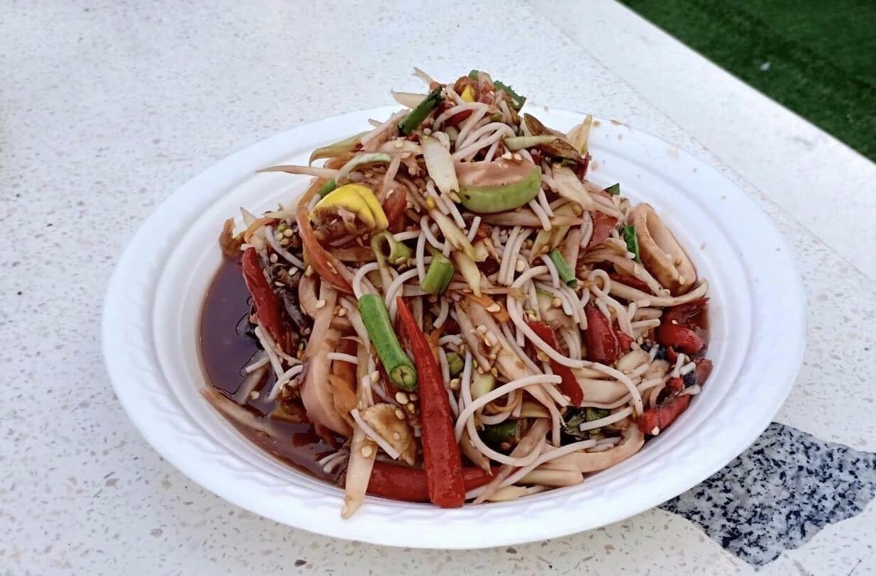 Tam Pha Bphaa Meuk: spicy green papaya salad with squid