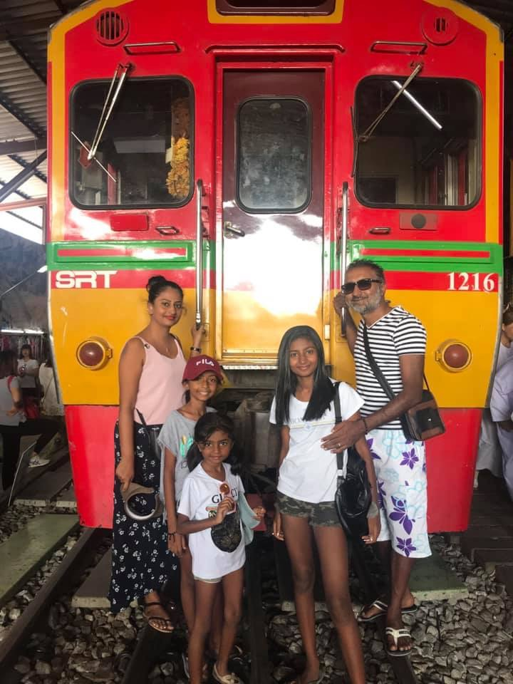 A cool family from France visiting the Maeklong Railway Market . Hope to see you again soon!