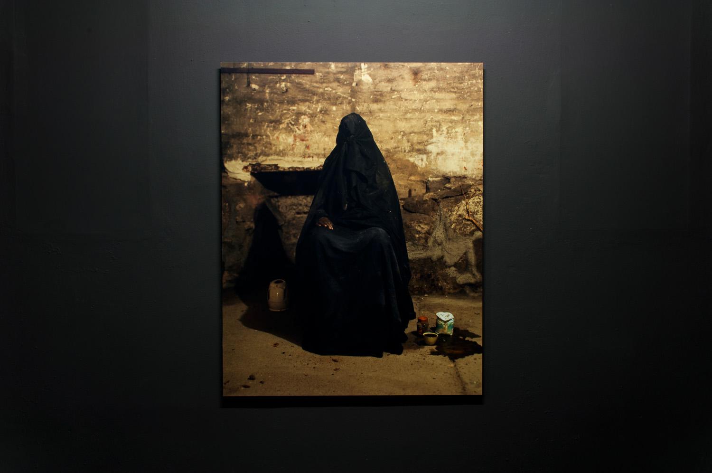 Dark figure with water boiler