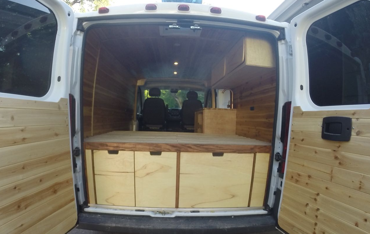 Custom shower/seat for van home, van life, custom made vans, camper van conversion, conversion van for sale, woodworking, custom cabinets, cabinet maker, custom woodworking, custom cabinetry, van shelving, custom van interiors, camper cabinets