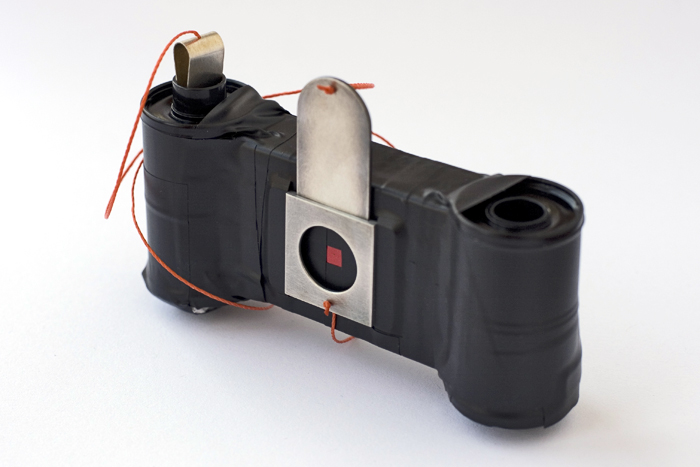 Matchbox Pinhole Camera in a Matchbox  Silver, steel can, electrical tape, nylon thread, matchbox; 2009