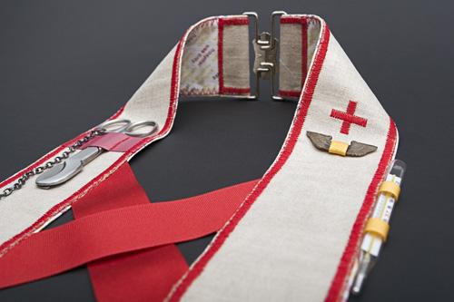 Uniformity [detail]  Linen, cotton hospital gown, nurse's accessories, silver; 2007