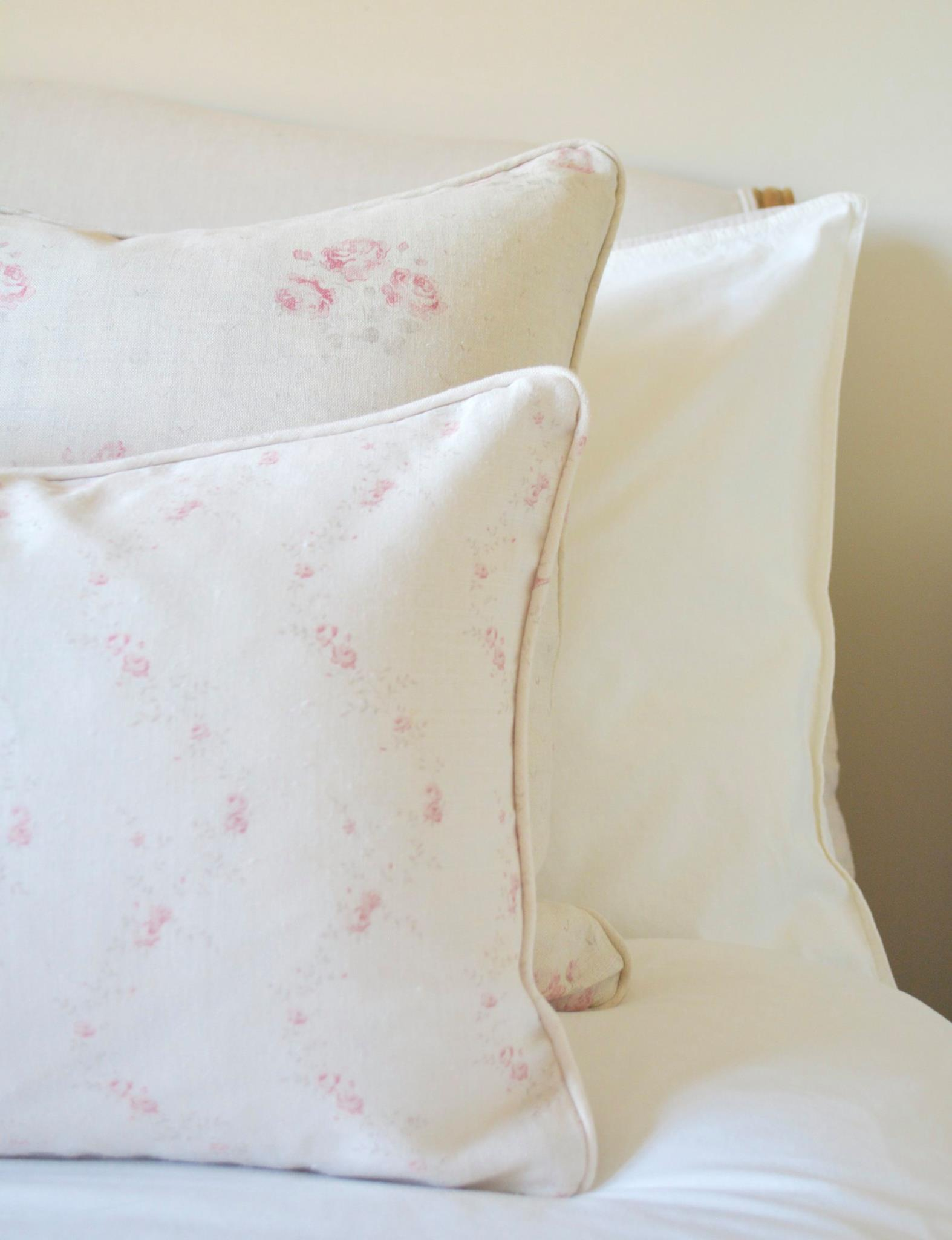 Cottage Bedroom with faded floral linens designed by www.hlinteriors.co.uk2.jpg