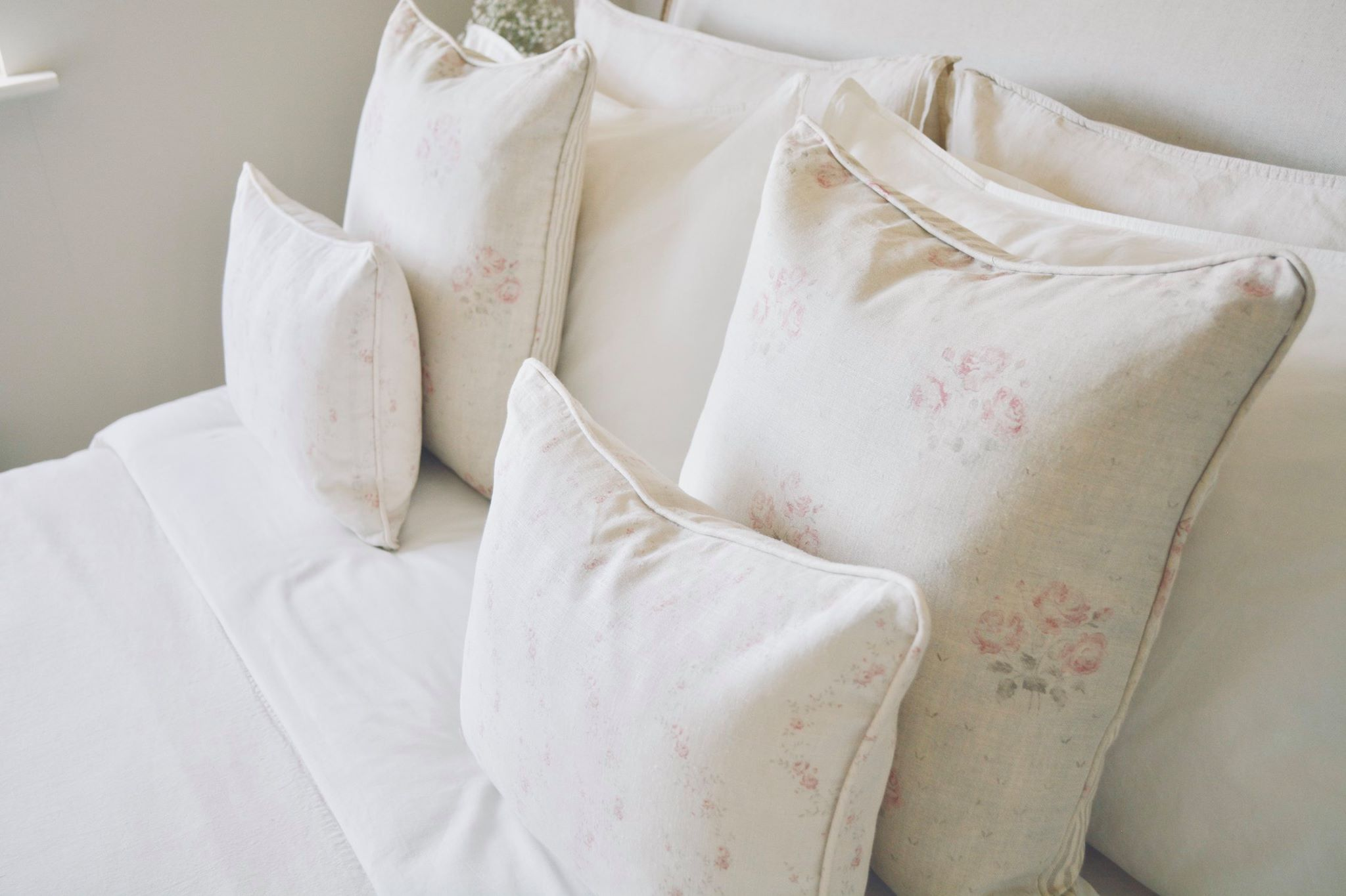 Cottage Bedroom with faded floral linens designed by www.hlinteriors.co.uk22.jpg