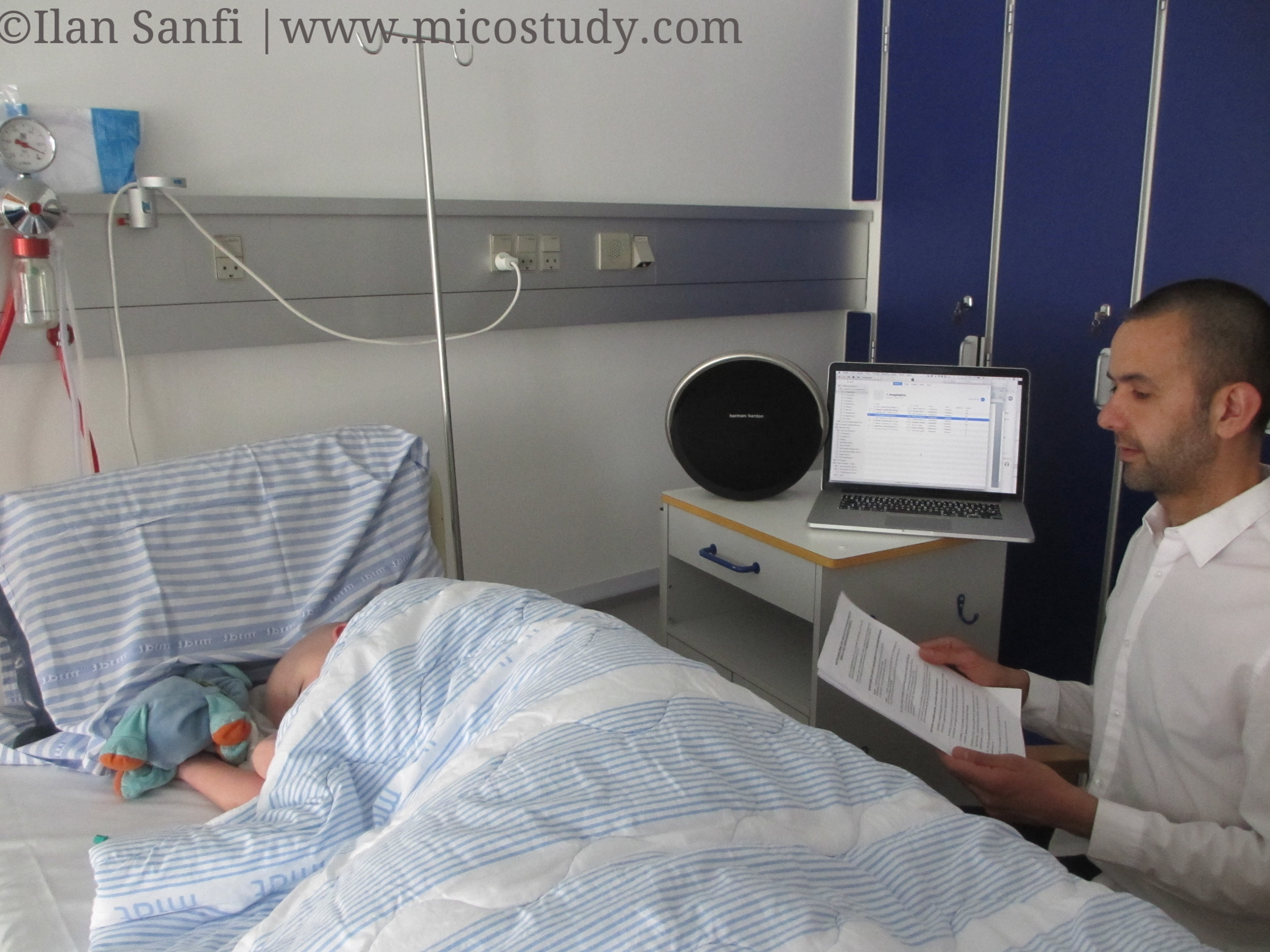 Ilan Sanfi reading one of the music imagery narratives for a 10–year–old boy in cancer treatment. The loudspeaker plays the specially composed music for that specific music narrative.