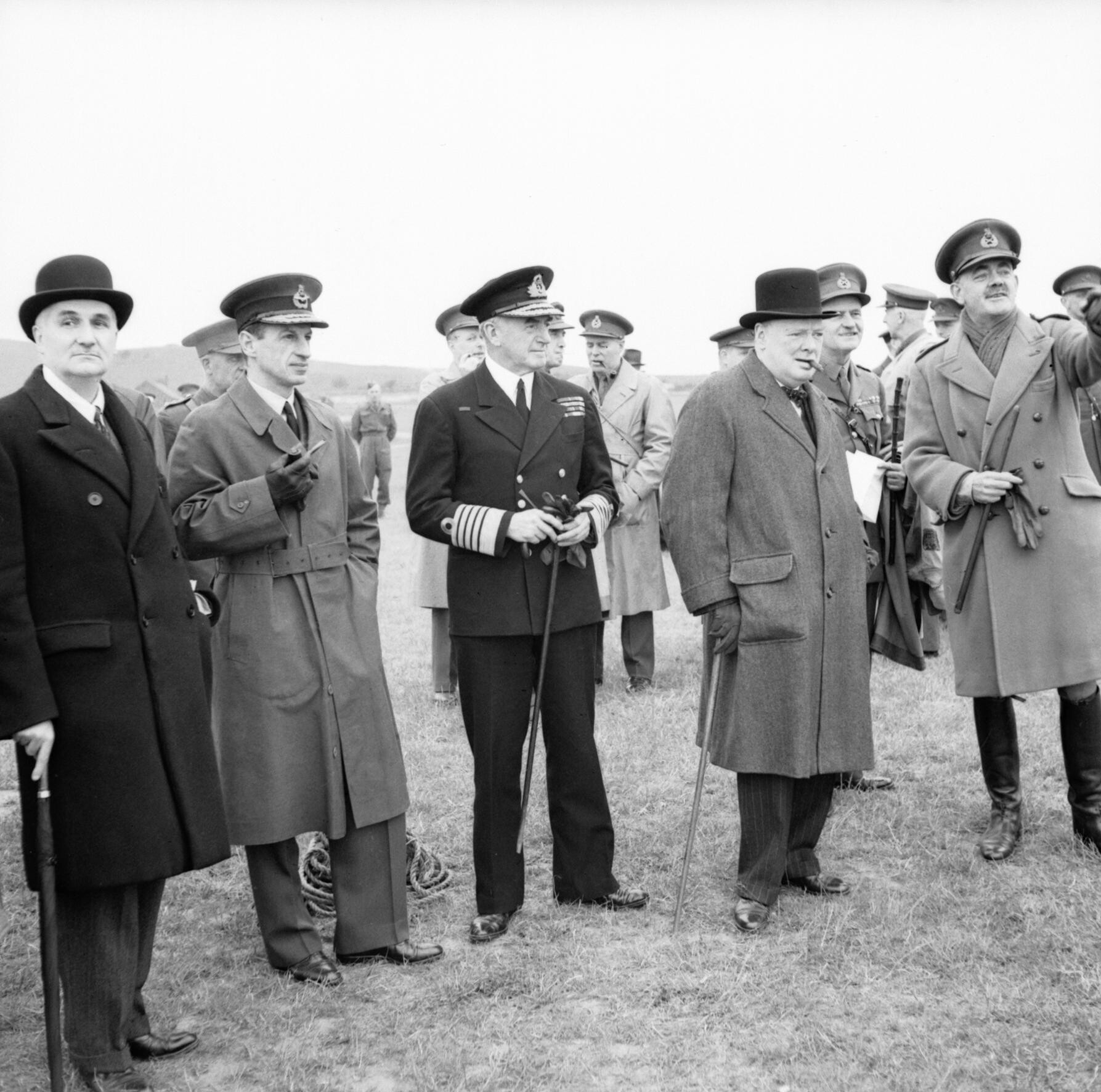 Winston Churchill with his scientific advisor Lord Cherwell (furthest to the left), Air Chief Marshal Sir Charles Portal and Admiral of the Fleet Sir Dudley Pound, watching a display of anti-aircraft gunnery, June 1941. Photograph owned by the Imperial War Museum.