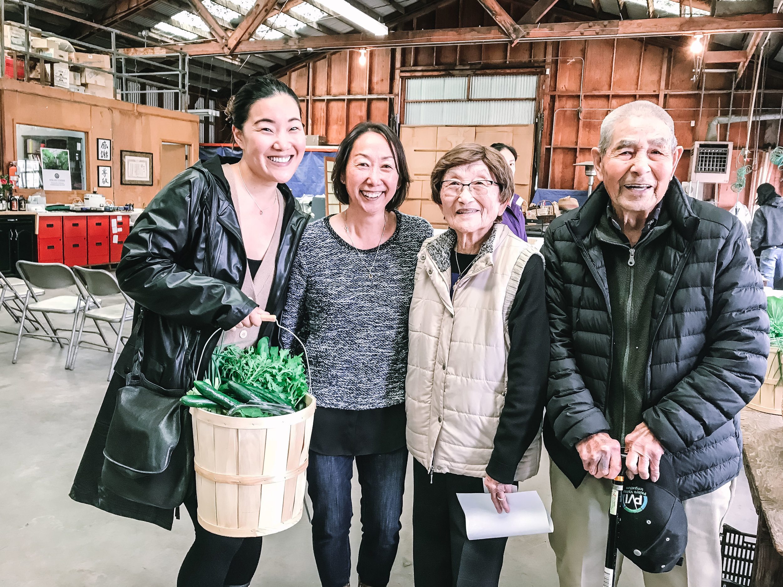 Janet and me with her parents, Mr. and Mrs. Nagamine, and the bountiful basket of farm produce they gifted me
