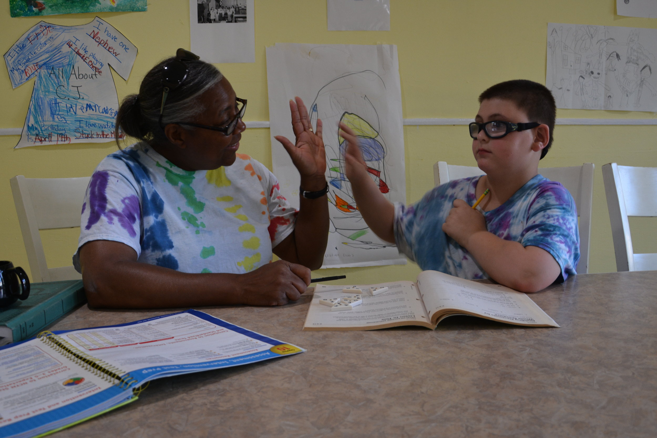 Student and Staff doing homework