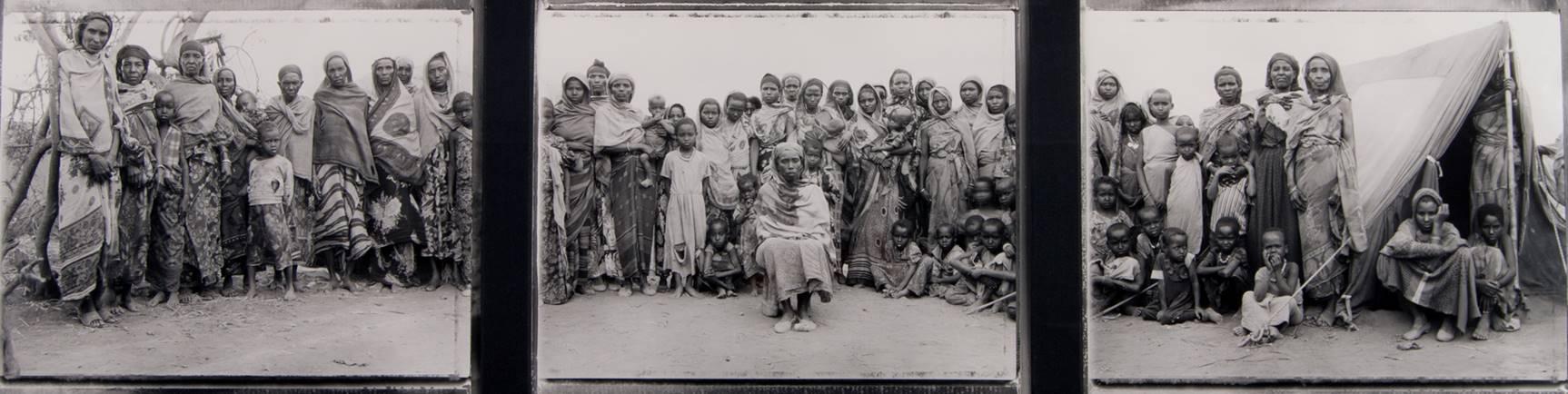 Fazal Sheikh  (American, b. 1965)  Gabbra Matriarch, Seated at Center, with Gabbra Women and Children,  1993