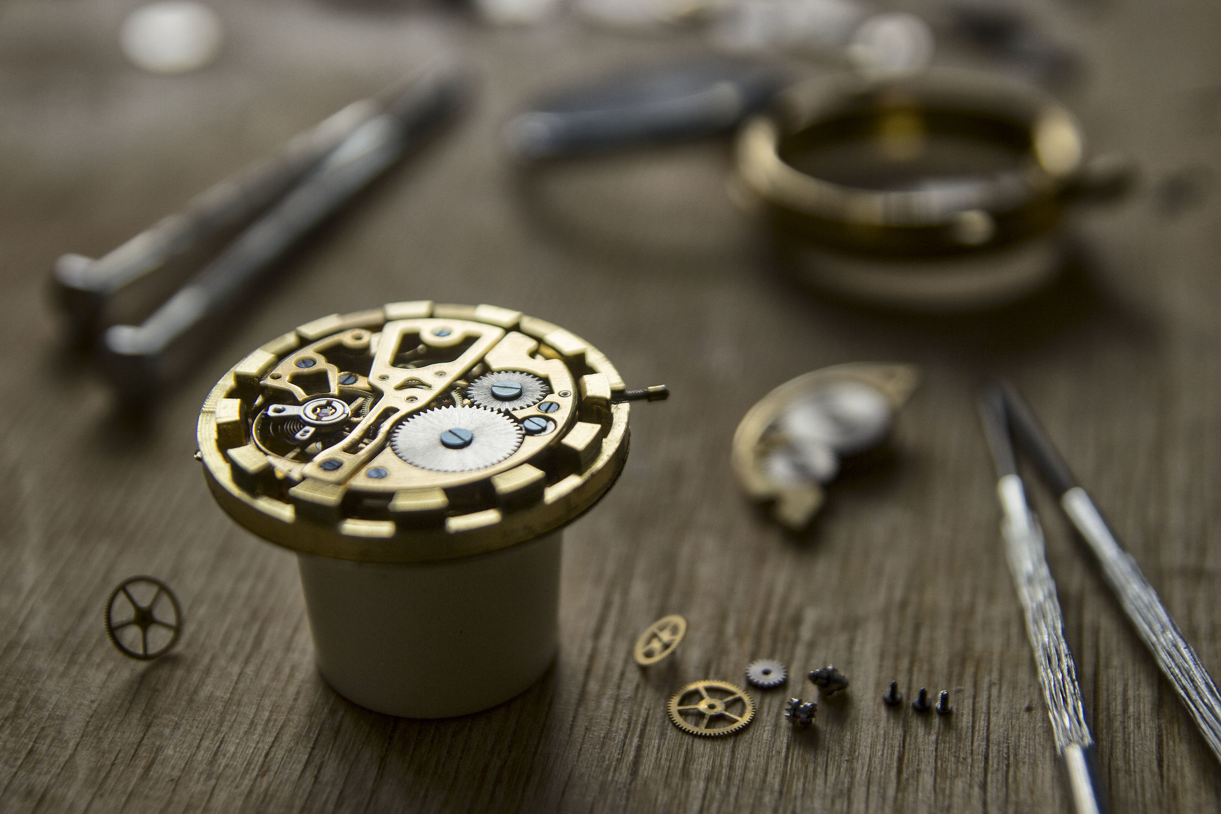 Deconstructed watch, gears, and timepiece.
