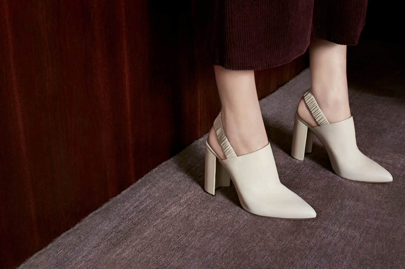 The Diane: Cream leather slingback pumps with a pointed toe, ruched back and curved block heel.