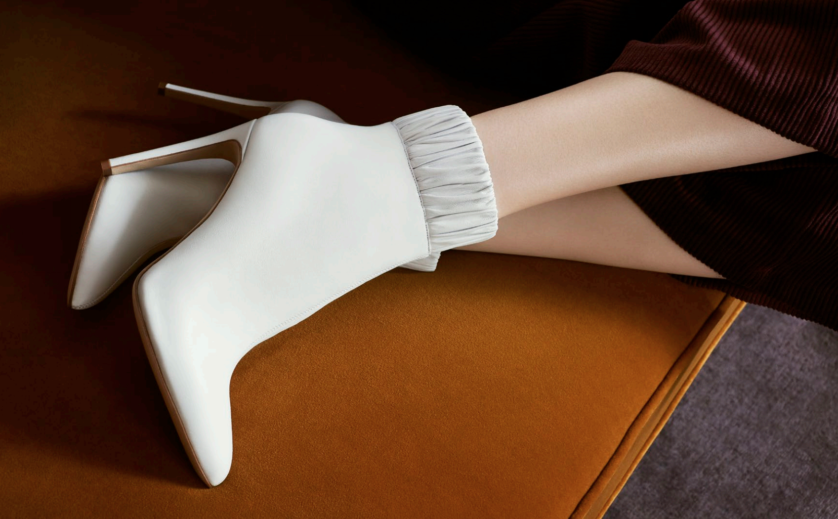 The Maud: White leather stiletto heel boot with ruched ankle. Coming soon.