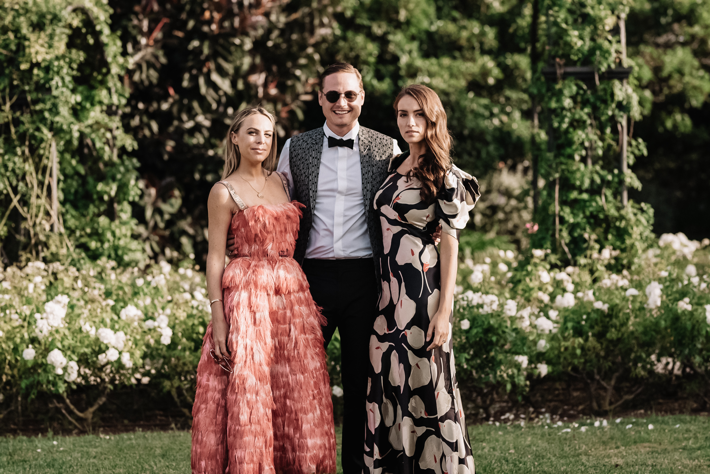 Chloe pictured at Morgan Curtis's wedding with Laurence Chandler and Taylor Olson.