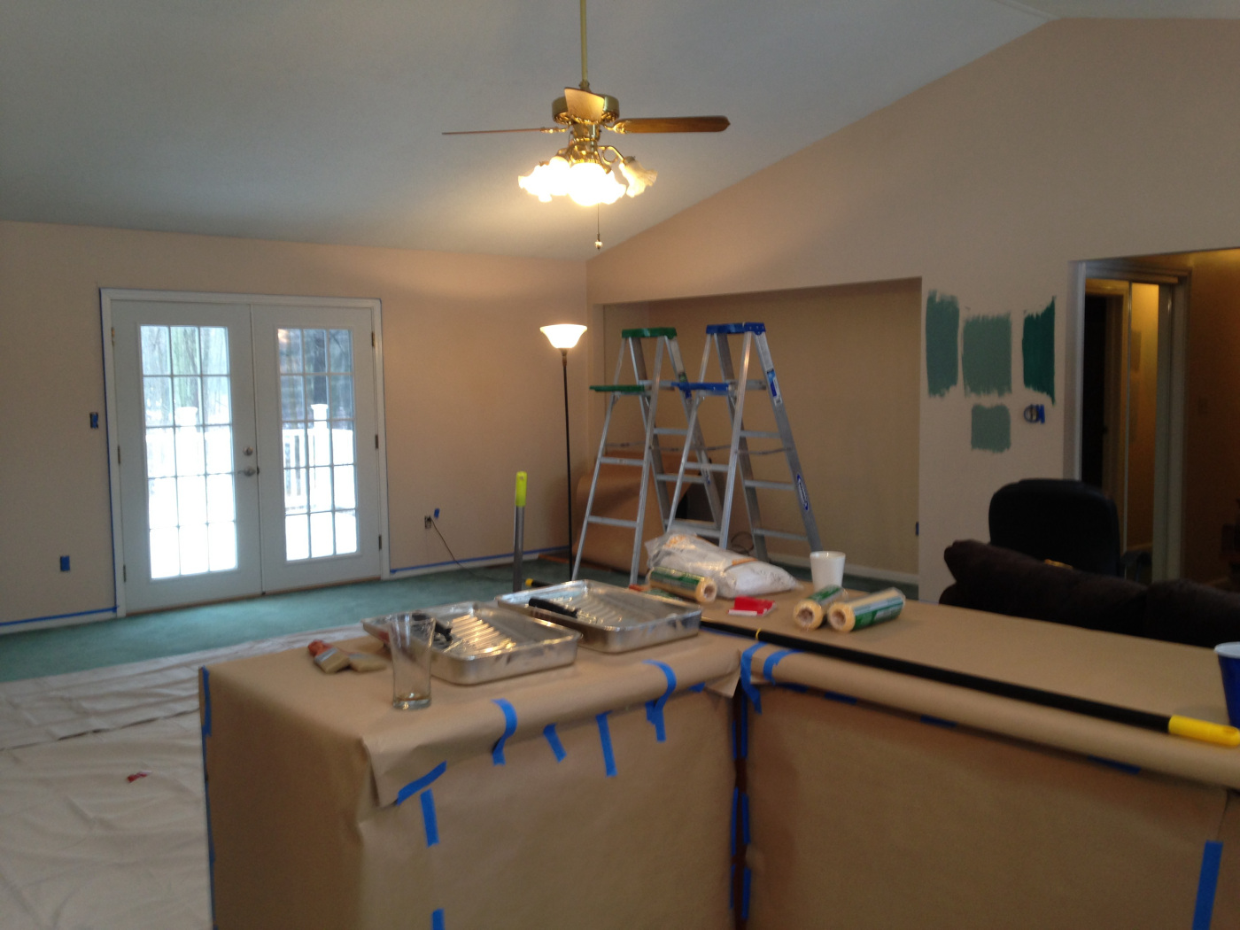 Getting ready! Testing out paint colors and covering anything we don't want covered in ceiling or wall paint.
