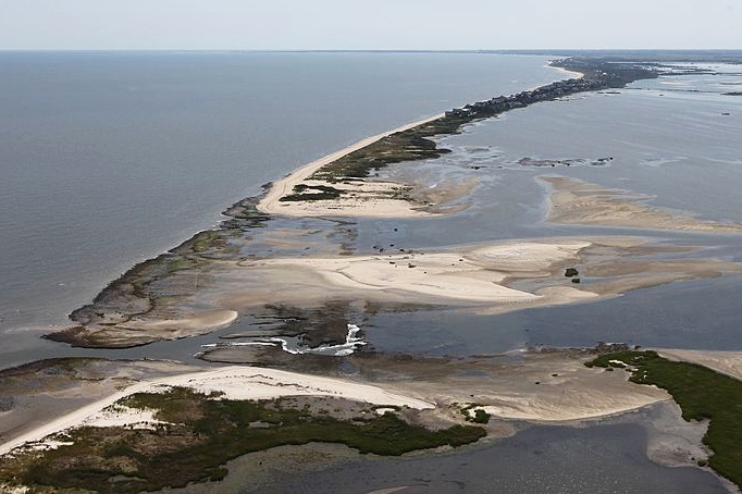 Aerial view of erosion along a tidal marsh on the Delaware coast.
