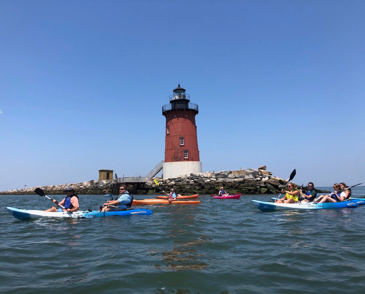paddlers at lighthouse.jpeg