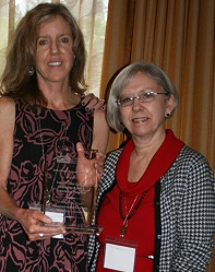 Julie Collier accepts 2016 2-Year Program of the Year Recipient Award on behalf of Folsom Lake College from 2015-16 Awards Director Marilyn Ashlin