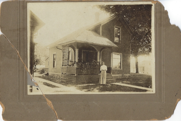 Mary Lochend in front of 511 W. Second Street, Flint Mich