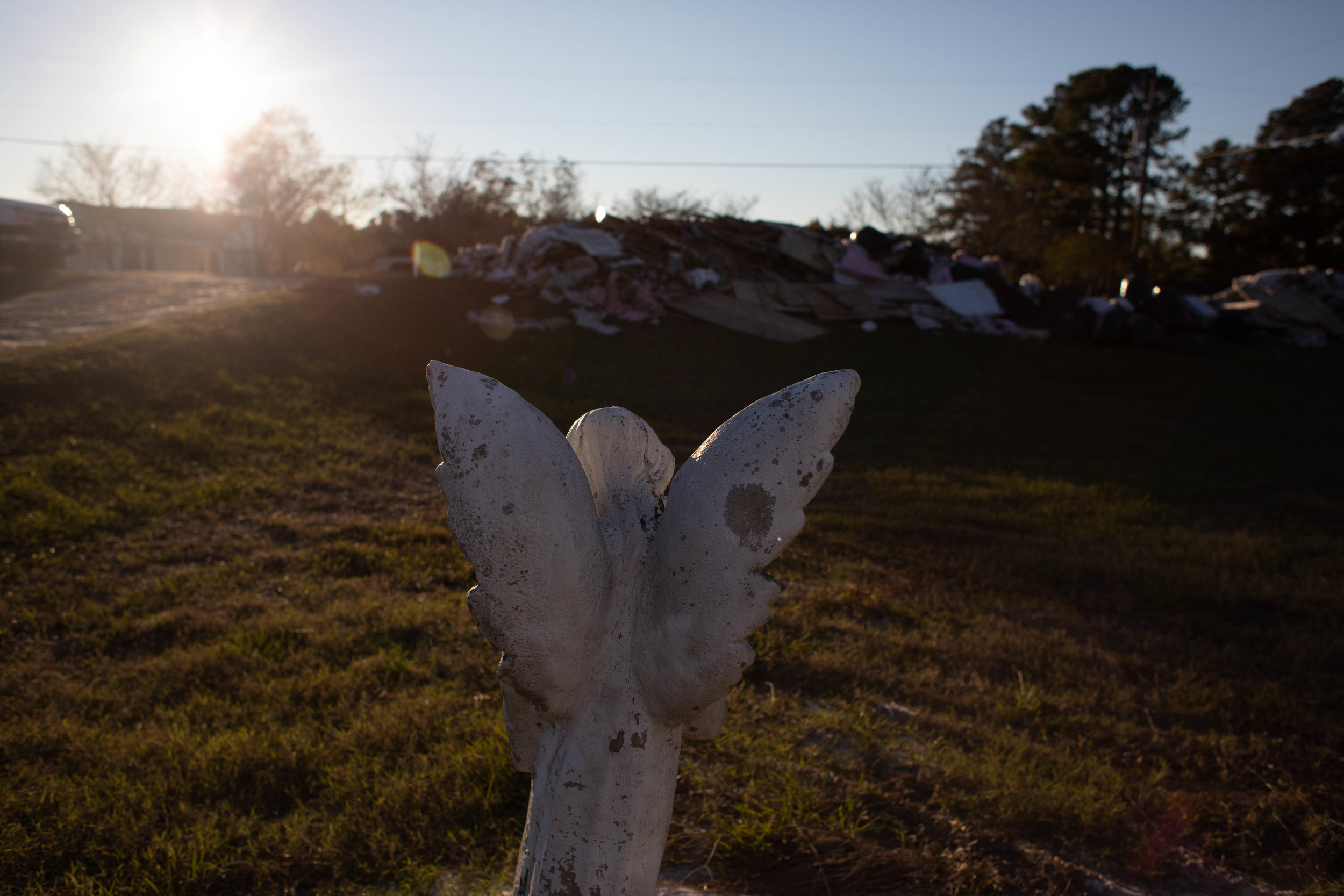 """An angel statue that Campbell's mother, Margaret, bought before she passed around the same time as the Hurricane Matthew. """"My primary reason is not to go in the house and get paid because we get 00 dollars, but to be the hands and feet of Christ,"""" said Riggs. """"[With] every meal [or house we rebuild] we make sure they understand we are doing this to share Christ [because] as much as they need money they need hope."""""""