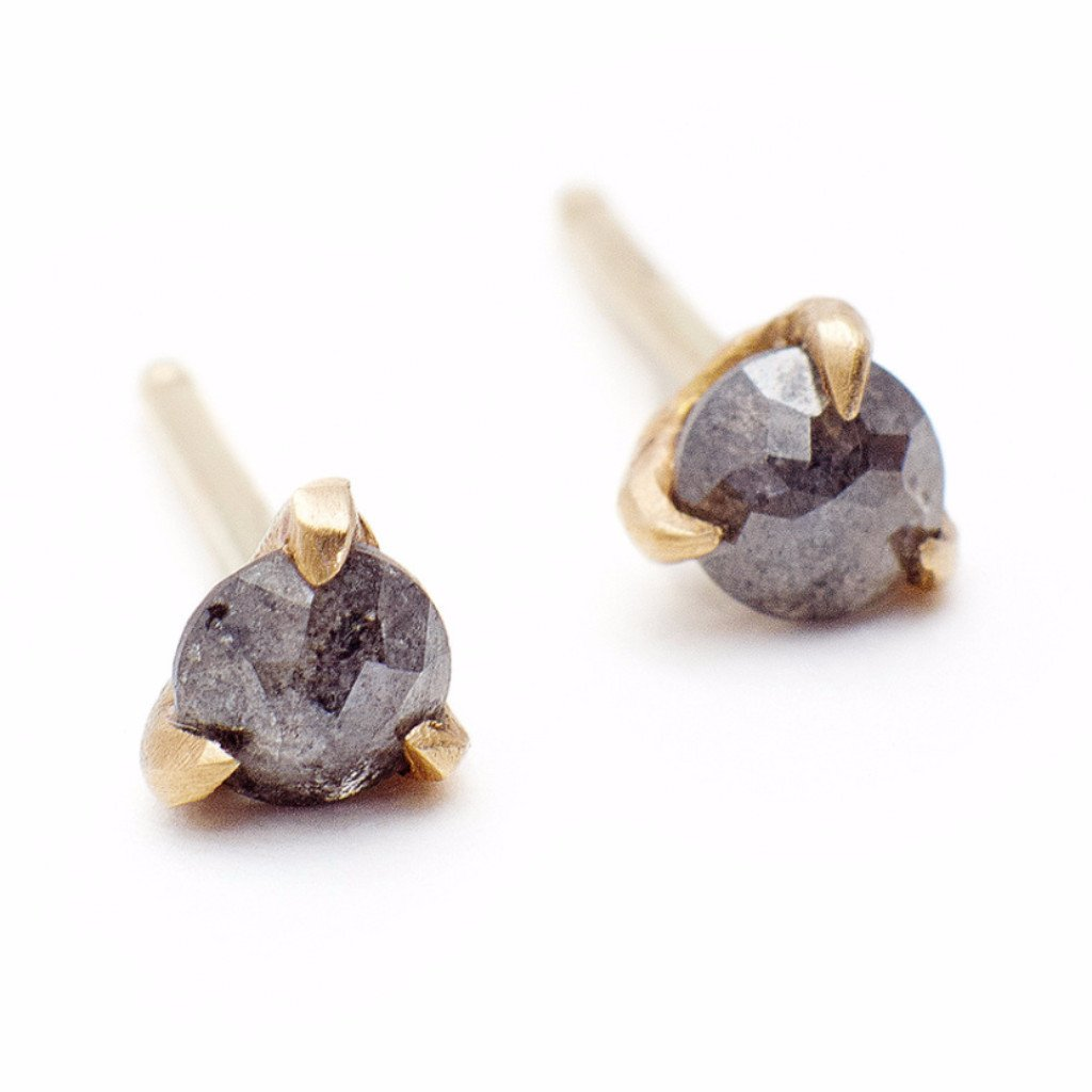 SLOAN DIAMOND STUds - We want diamonds but not Upper East Side diamonds. We want moody carbon studs; raw and gritty. We want diamonds with a back story, a past, a reputation. These dark grey, rose-cut diamonds are clawed by 14K yellow 100% recycled gold and handmade in Brooklyn by designer Vanessa Liane, who forges all her designs using the strictest of standards. All of Vanessa's pieces are made with natural stones that are ethically sourced. Diamonds are reclaimed and sourced through vendors that adhere to the Kimberly process (familiarize yourself - it's really important).$595