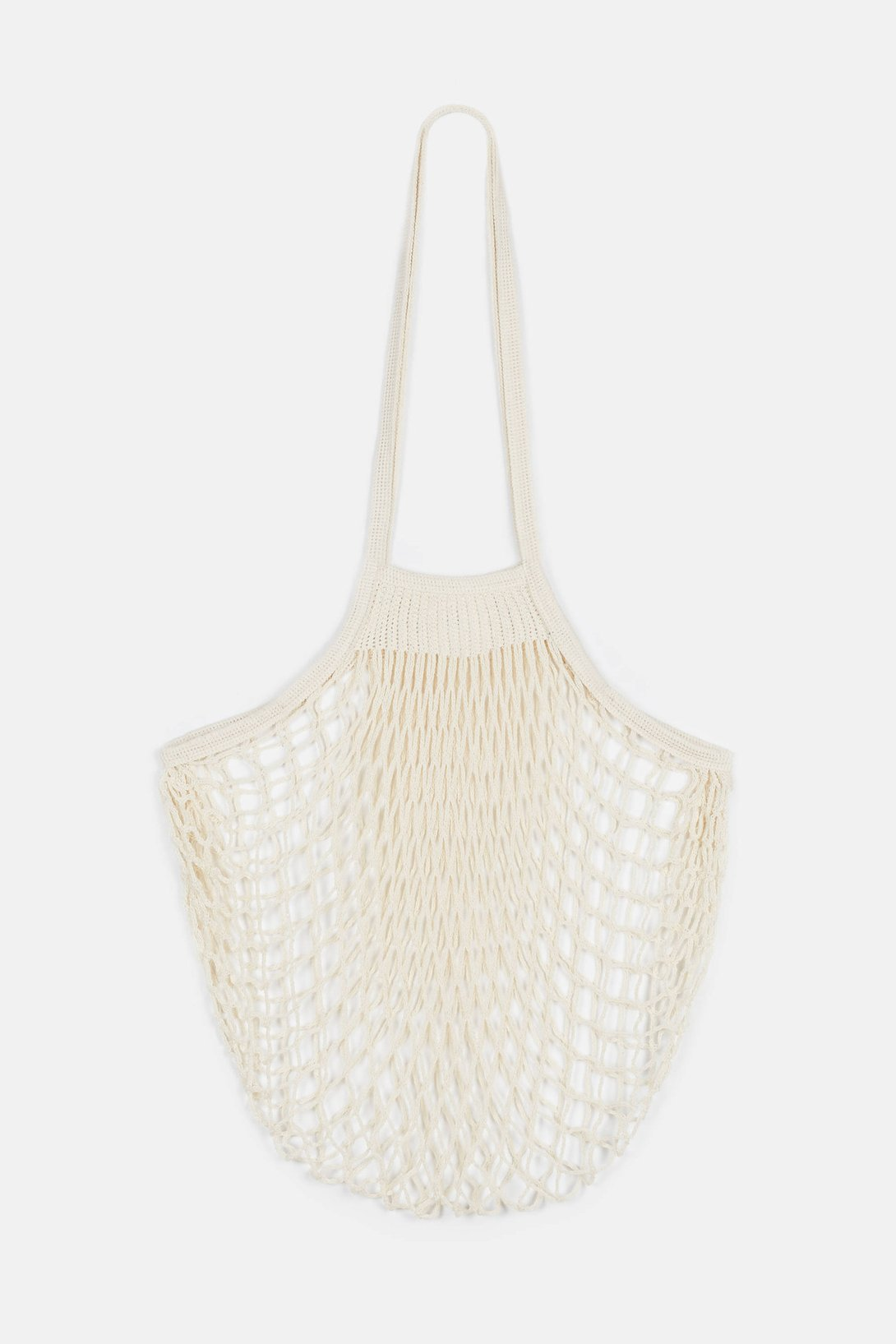 """Filt Large Net Bag - Natural - This cotton, machine-washable bag, originally made for fisherman are called simply, """"filet,"""" in France. Eventually, the bags gained a wider appeal as a light and flexible tote that can be used for everything from groceries to laundry. We use one to haul bunches of celery from Trader Joe's to our apartments so we can make our daily portions of celery juice. We've mentioned it a time or two, but just in case you weren't paying attention, read about it here.$22"""