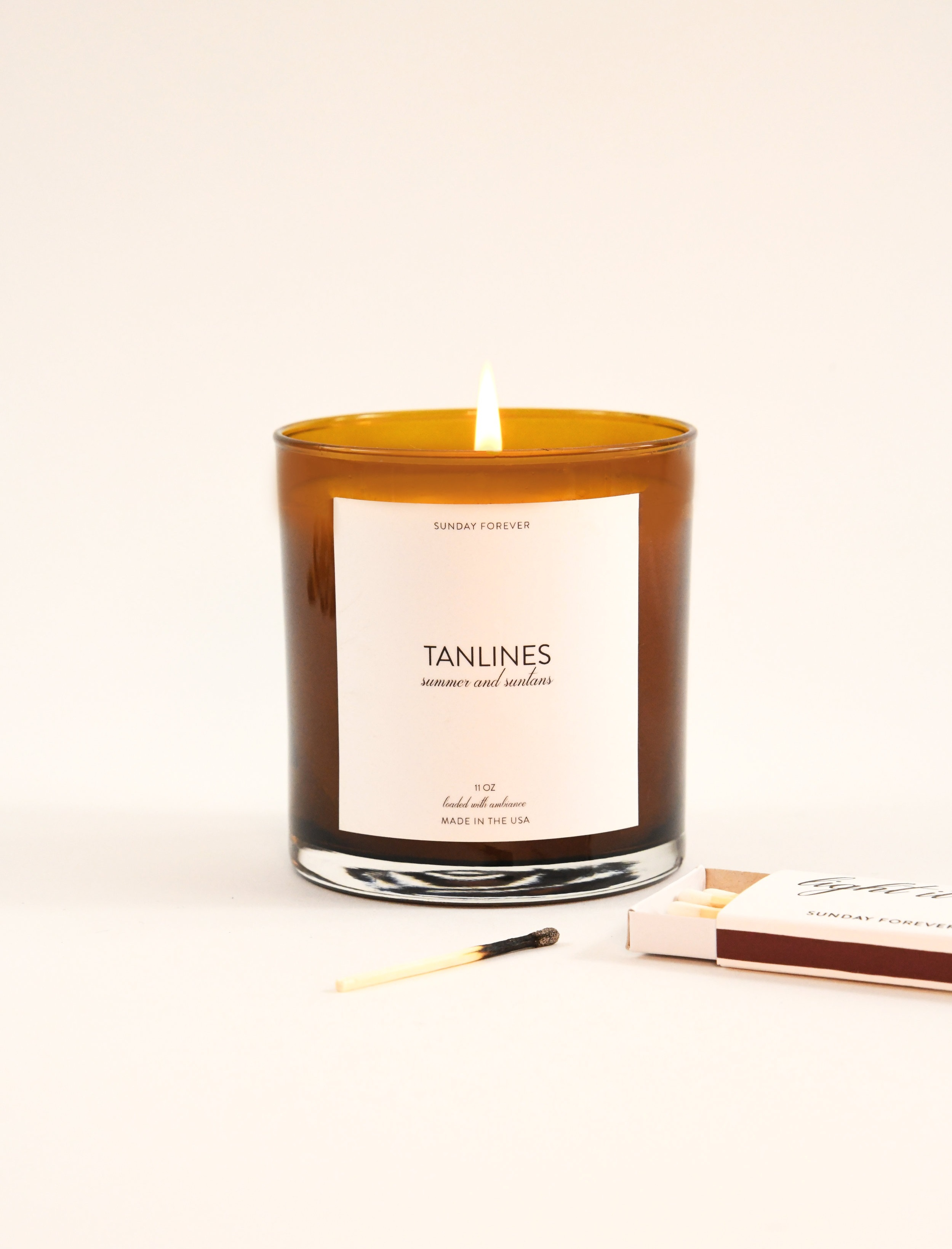 "SUNDAY FOREVER TANLINES CANDLE - ""Mom"" needs more than a ""Calgon Take Me Away"" bath. She needs a full-on tropical vacation. Our best-selling, cult-favorite Tanlines candle has been known to simulate the summer beach vacation experience. It smells like summer and suntans. When lit she'll feel like she's lounging on the lanai, umbrella drink in-hand, watching the sunset while Tom Hardy fans her with giant palm leaves. Don't you want to be Mom's favorite child? This will do it."