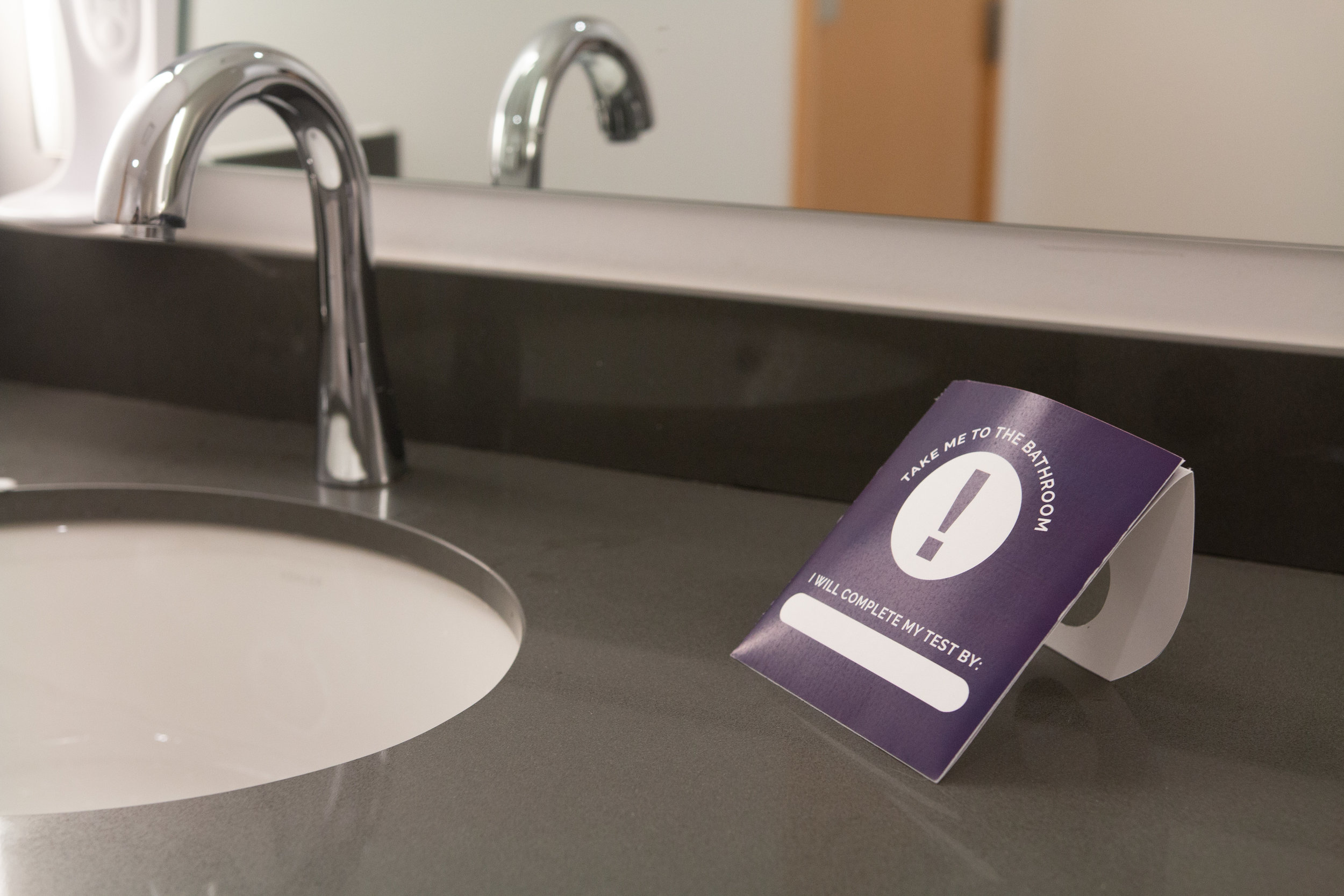 Hanger can sit on bathroom counter to nudge behavior to use