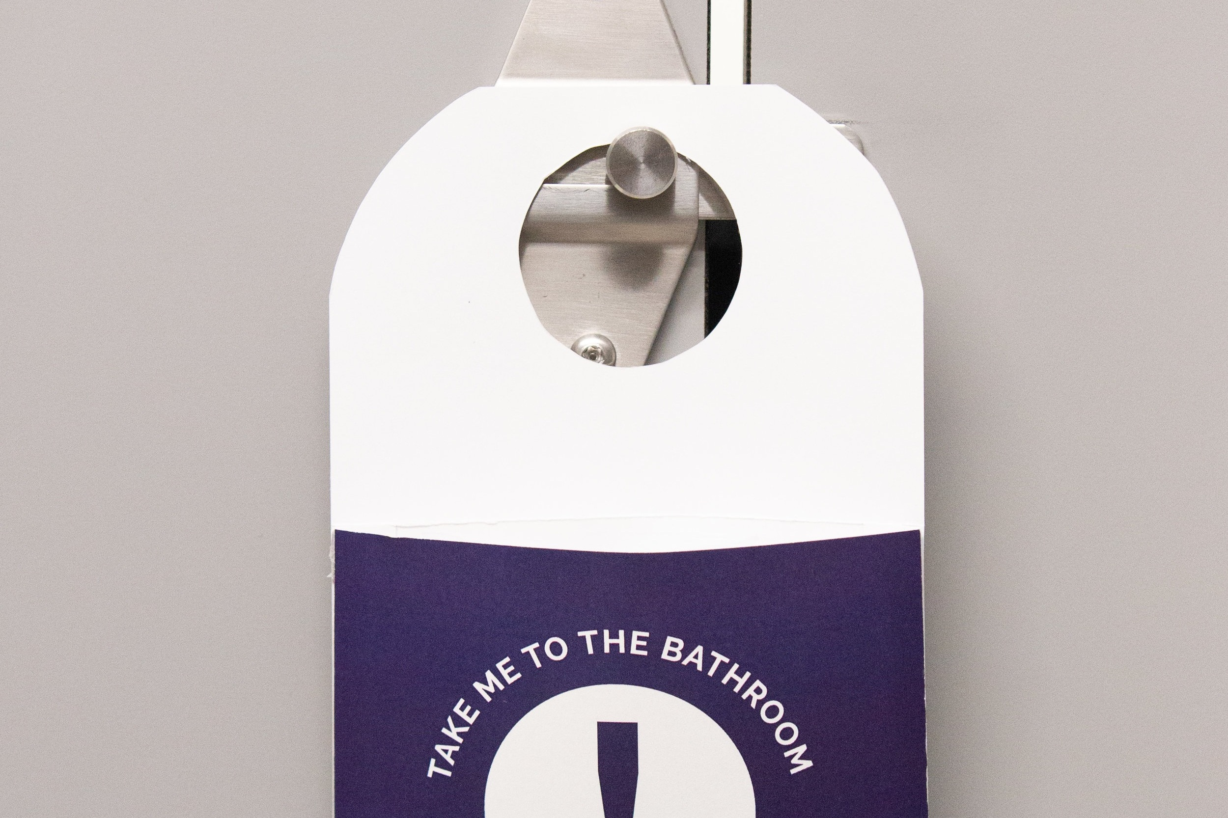 Hanger can easily hang on bathroom door with test contents