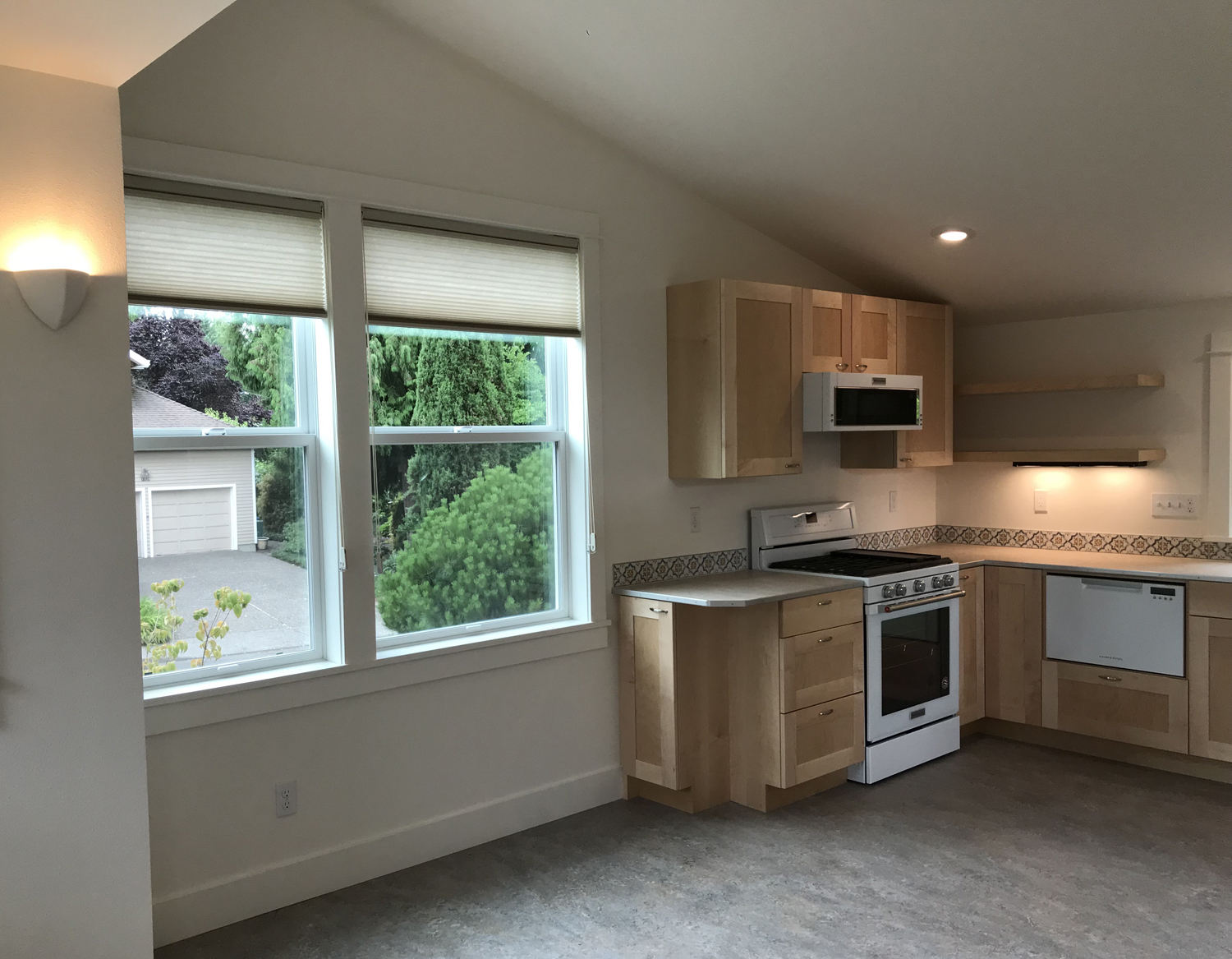Stove, oven, microwave/vent hood, west facing window.