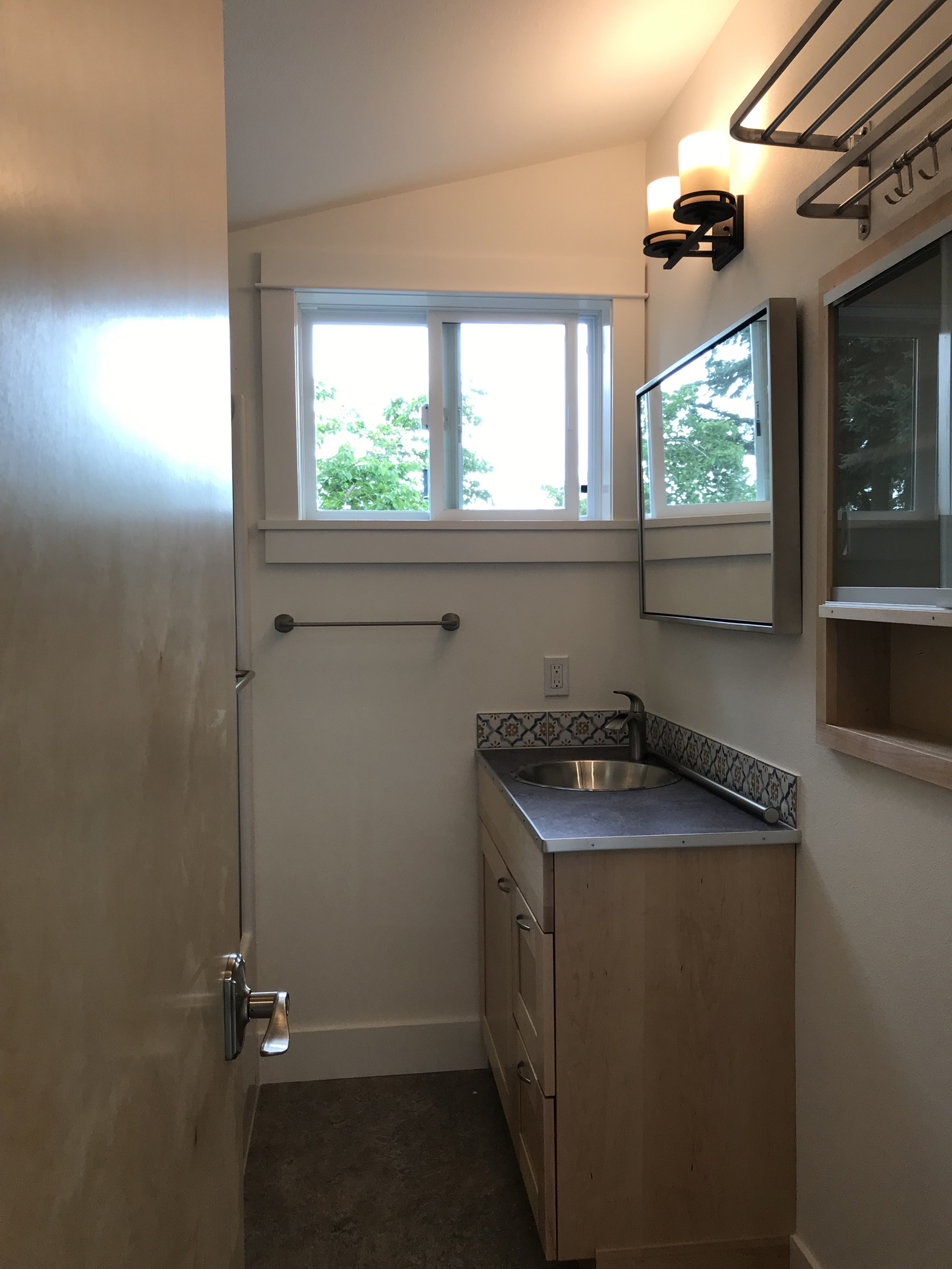 Bathroom cabinet/sink area.
