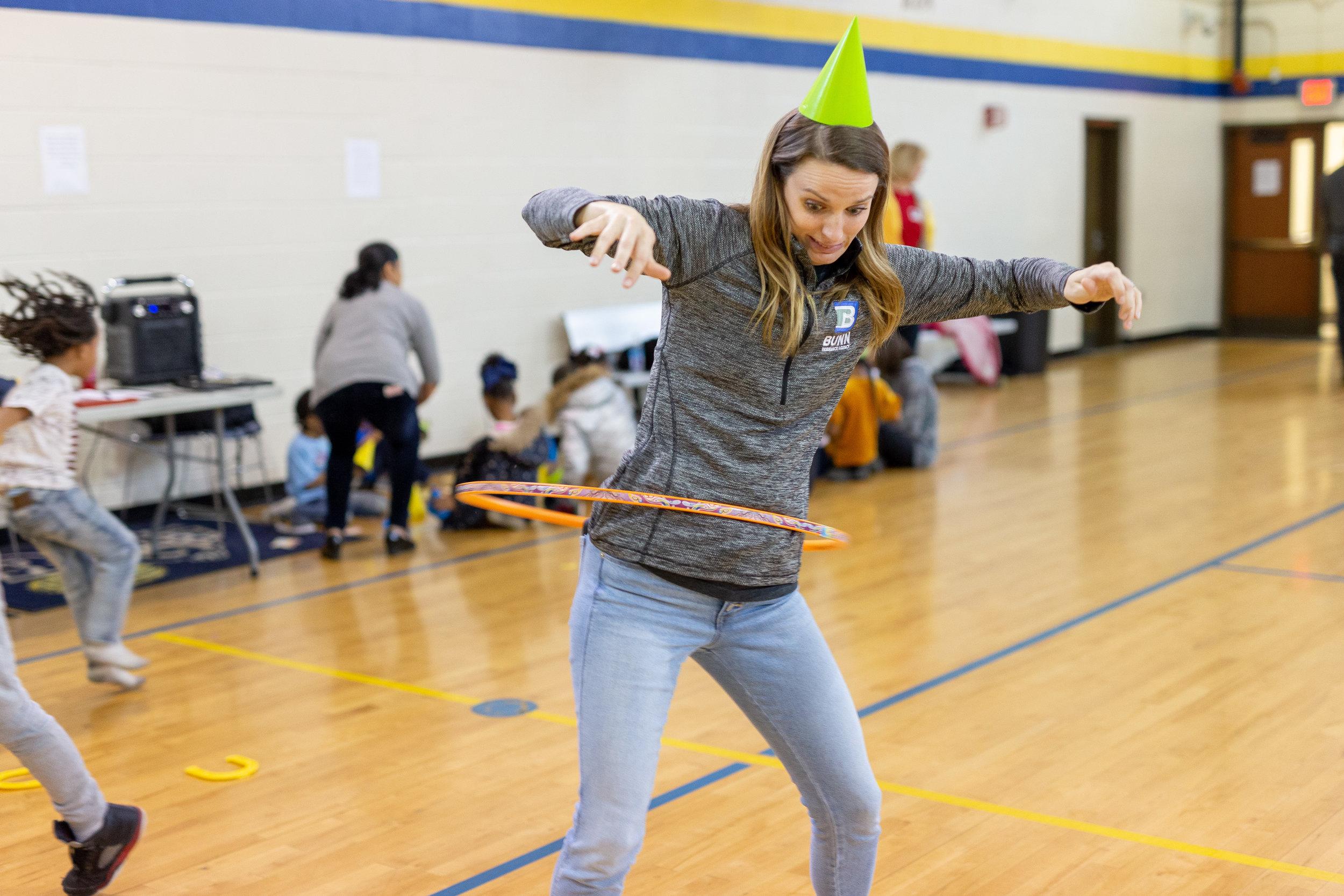volunteer with hula hoop.jpg