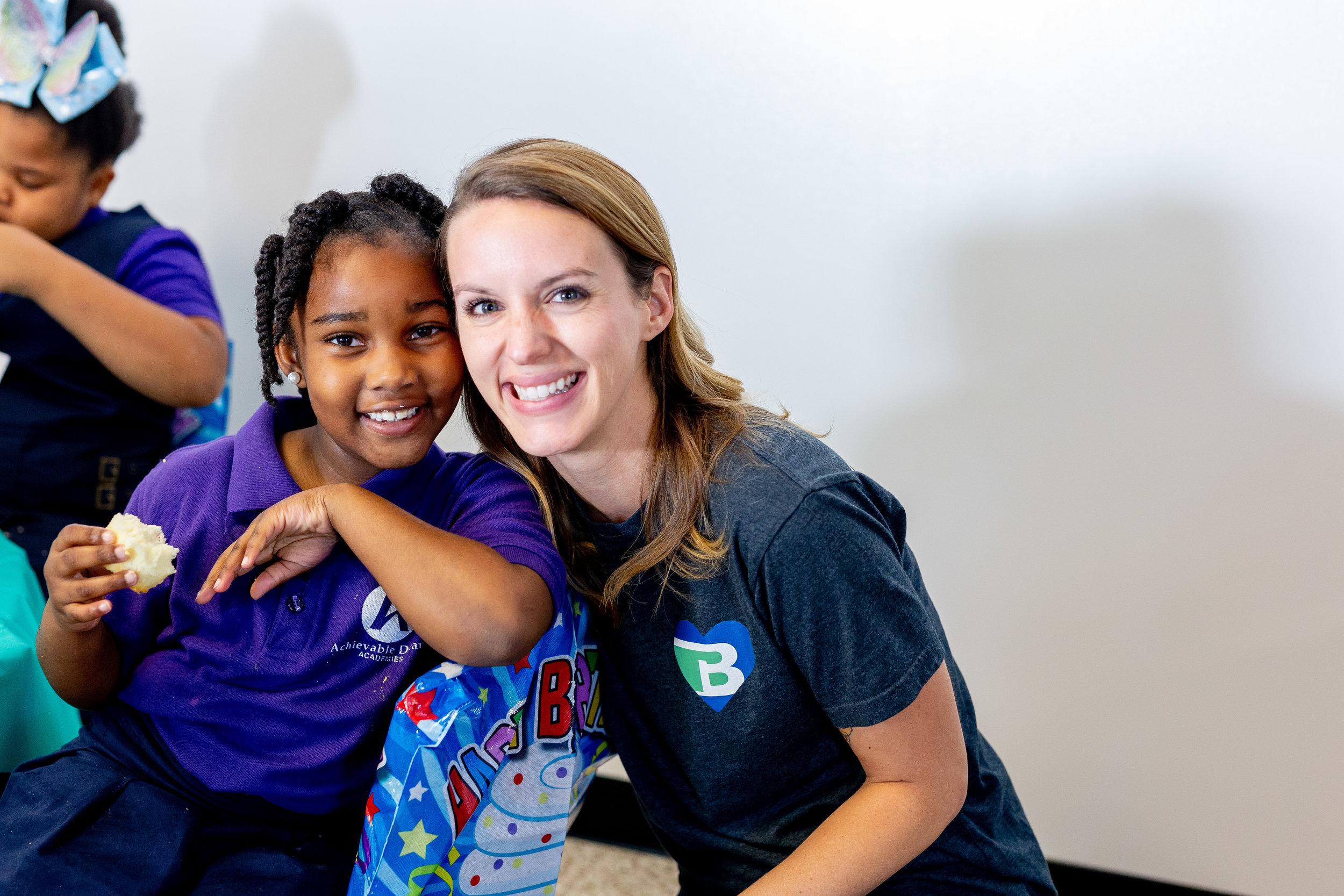 volunteers with kids.jpg