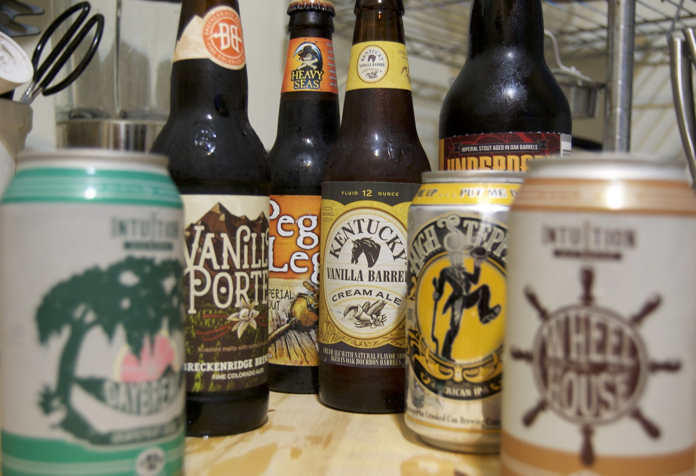 Here's a few I've picked up from around town. - Here's a few I've picked up from around town. In no particular order, sorry some are out of focus.-The Vanilla Porter from Breckenridge Brewery is always excellent. Smooth, and dare I say silky. I dare. I dare. -The Kentucky Vanilla Barrel Cream Ale is like drinking cream soda. Definitely worth a try, and another, and another. Put it on some vanilla ice cream, and watch a movie.-Towards the front we have Wheelhouse Brown Ale, a seasonal offering from Intuition Ale Works. A very drinkable beer. Very smooth. I really hope they decide to make it a regular offering.-The Intuition Daybreak Grapefruit IPA was surprisingly good. I'm not usually an IPA guy, but I enjoyed this tart brew. I'd like to drink it at a picnic, or outside event.-High Stepper American IPA was good as well. Tart and bitter, but pleasing. I think I'd have it with something low key like fish or noodles. Everything that Crooked Can Brewing has made has been good. -In the back is Peg Leg. I haven't tried that one yet.-In the way back is Underdark, a limited yearly release from Intuition Ale Works. I shared this with some friends, and it was excellent. Toffee, chocolate, deep and rich. These are the beers I live for. I want to drink it while playing Cards Against Humanity.Note: I didn't drink all of these in one day, or even two days. Drink Responsibly!