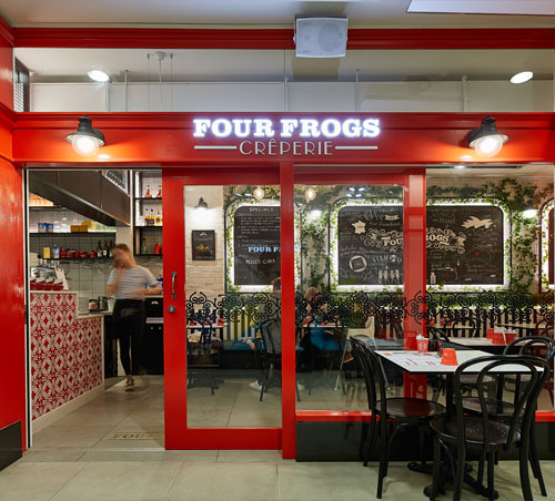 Four Frogs Créperie - Immaculately designed by Morris Co Design, the decorative features and greenery within this creperie create an inviting and delightfully French atmosphere. This 90m2 full restaurant fitout comprised of shopfront, commercial kitchen, and dining area.