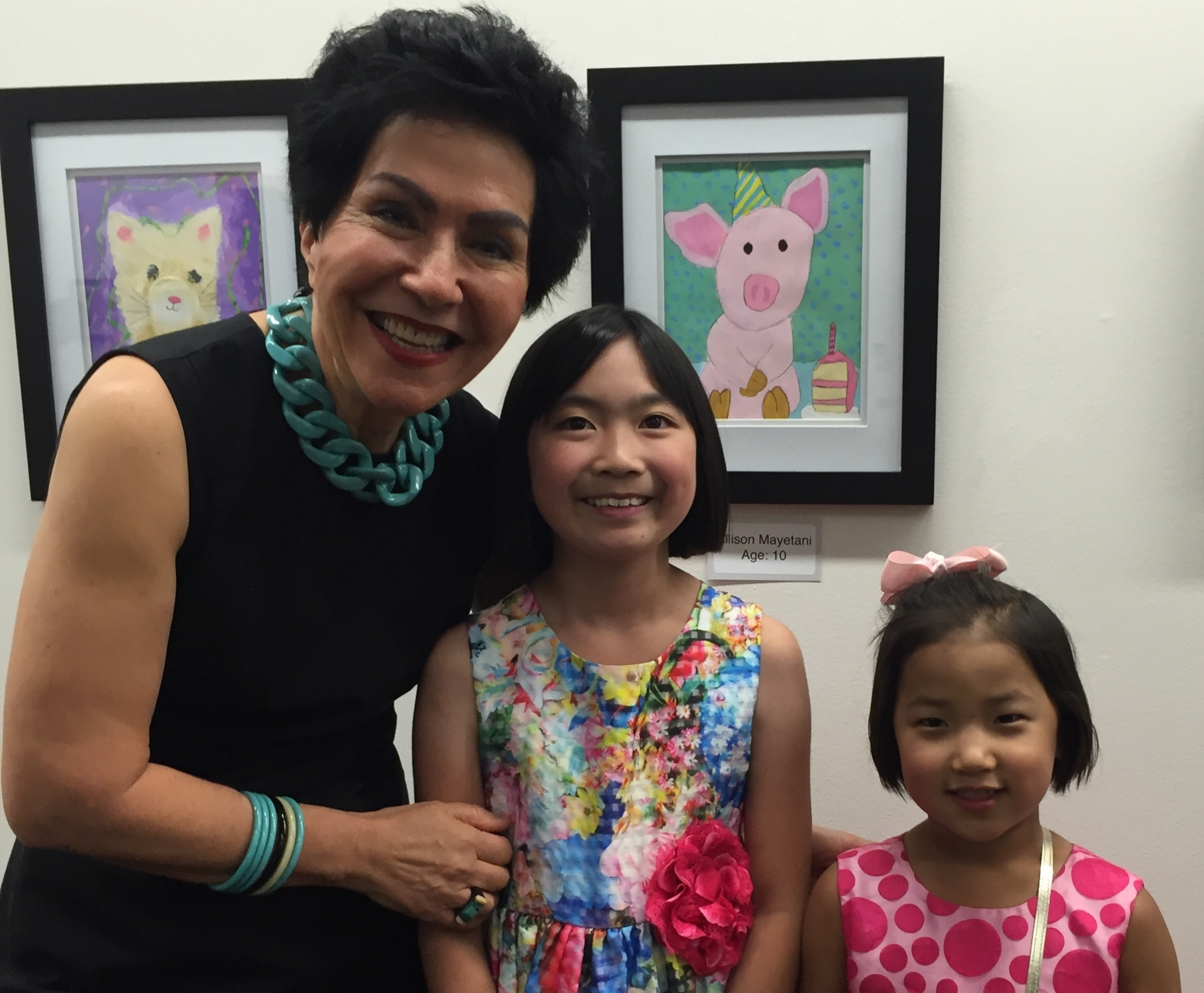 Fahimeh with her students at the Salt Lake City library, where she exhibits their artwork each year