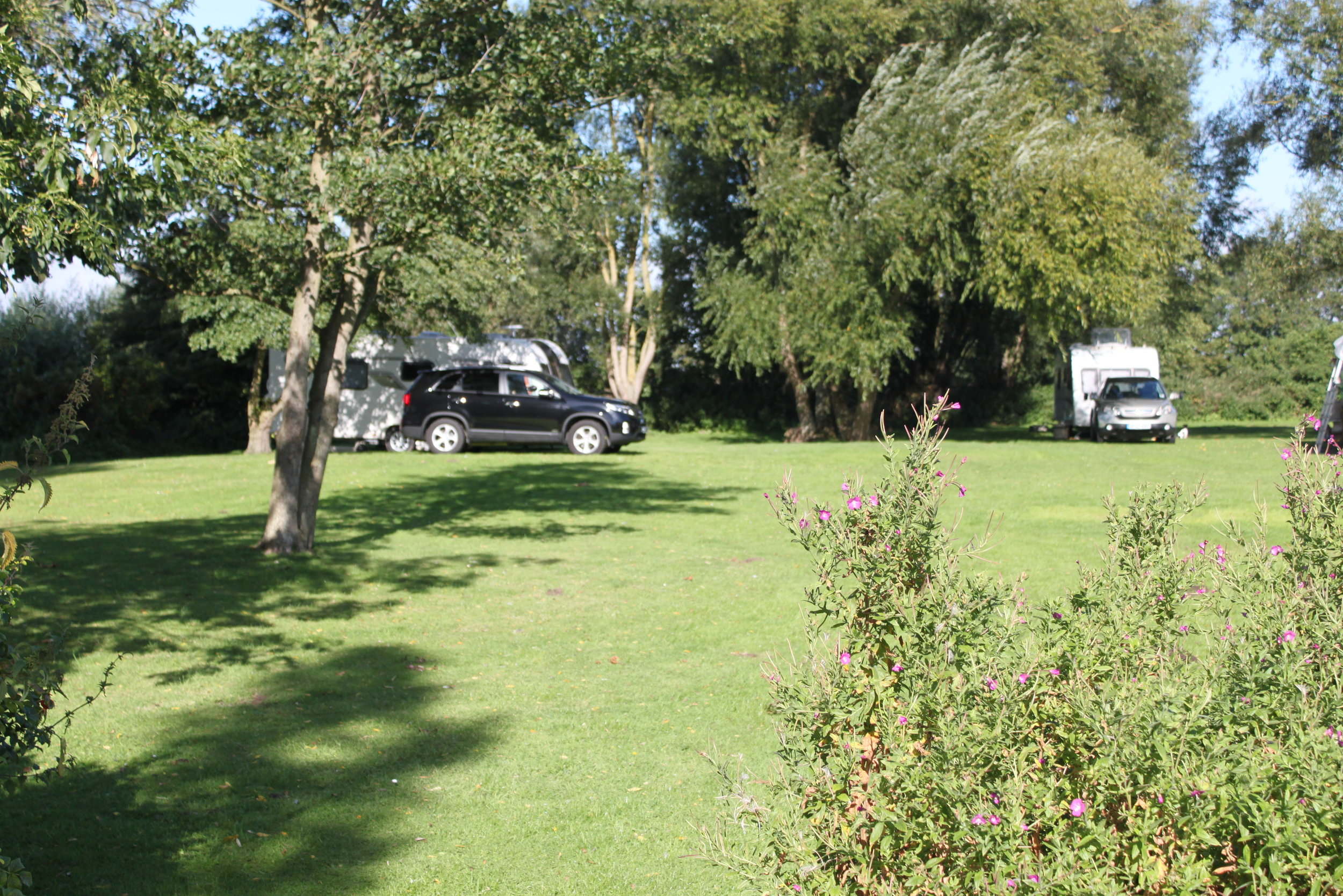 - We are a certified location for the Caravan Club & Motorhome Club. Five spaces are available for caravans and motorhomes, being next to the lovely town of Beccles its very popular and we have many people returning each season.Arrival time is any time after midday, and departure time is before midday on the day of departure.We have electric hook up, drinking water, ladies and gents toilets and toilet waste disposal. Free WiFi is available on site.Dogs are welcome, but must be on a lead at all times and any mess cleared up.The cost is £15 per night