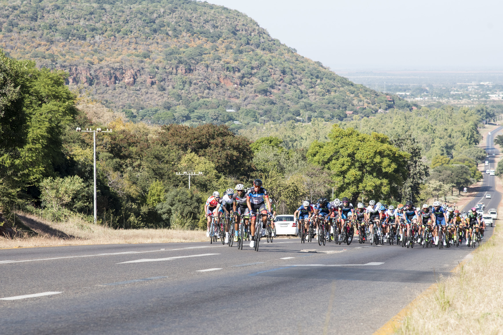 Soon after the neutral zone on the outskirts of Bela Bela, the first attacks began early in the day from Bela Bela to Polokwane on Stage 1 of the 2019 Tour de Limpopo (UCI 2.2) from 14-18 May © Tour de Limpopo/Andrew Mc Fadden