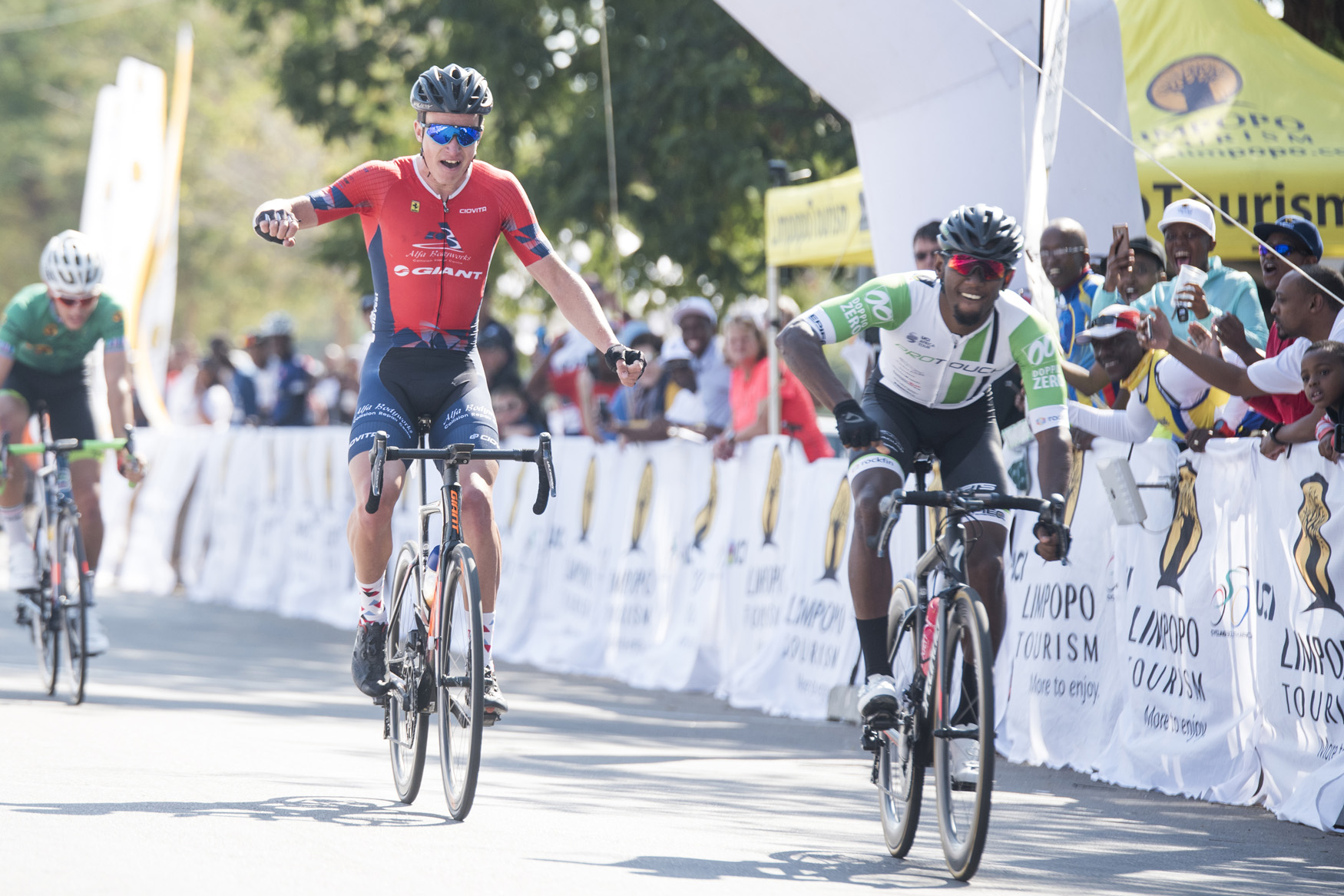 ProTouch Continental's Clint Hendricks hammers his handlebar in jubilation as Hendrik Kruger (Alfa Bodyworks Giant) realises his defeat at the end of the stage from Tzaneen to Peter Mokaba Stadium, Polokwane, on Stage 4 of the 2019 Tour de Limpopo (UCI 2.2) from 14-18 May © Tour de Limpopo/Andrew Mc Fadden
