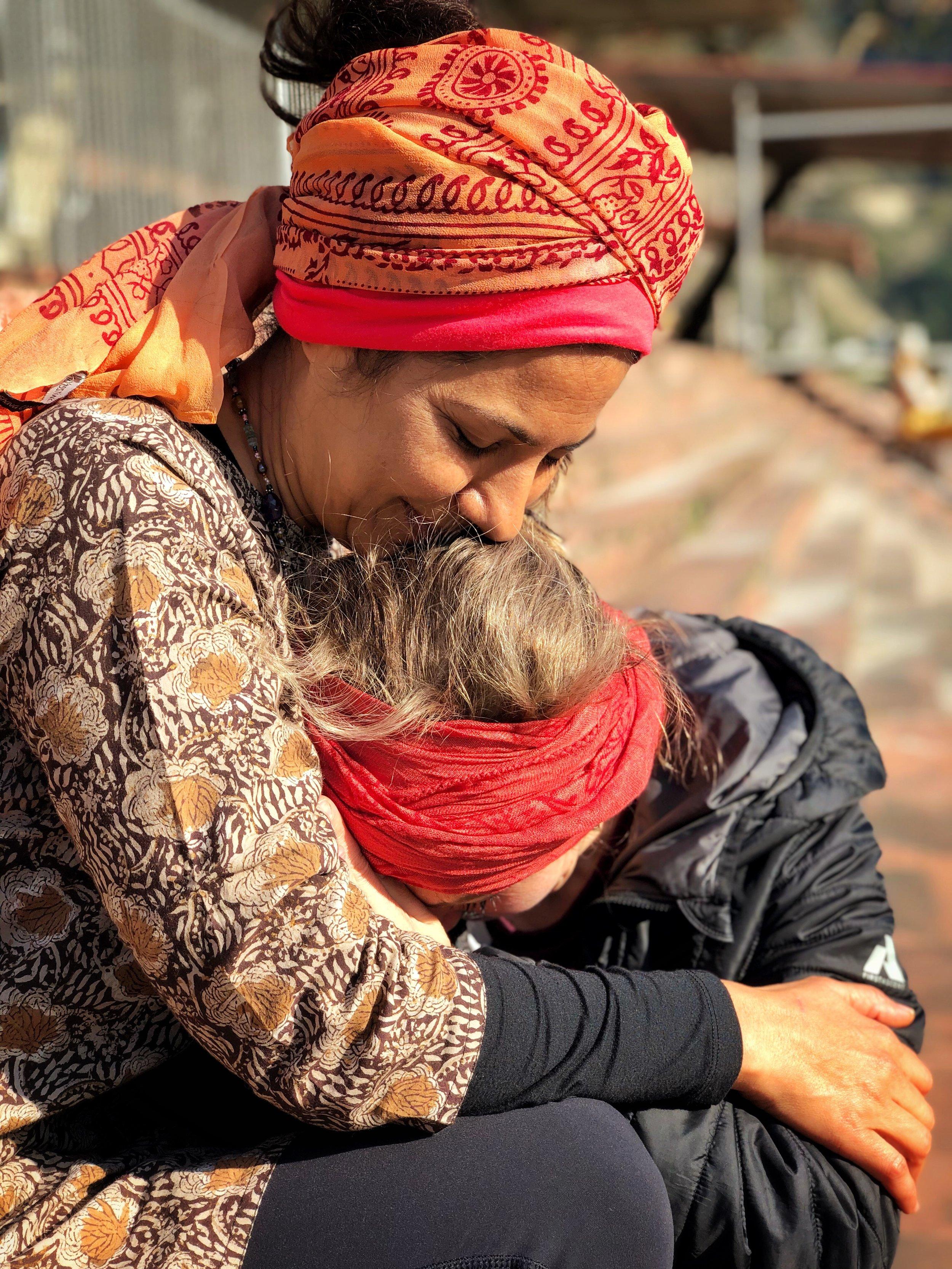 Veechi Shahi hugging a guest