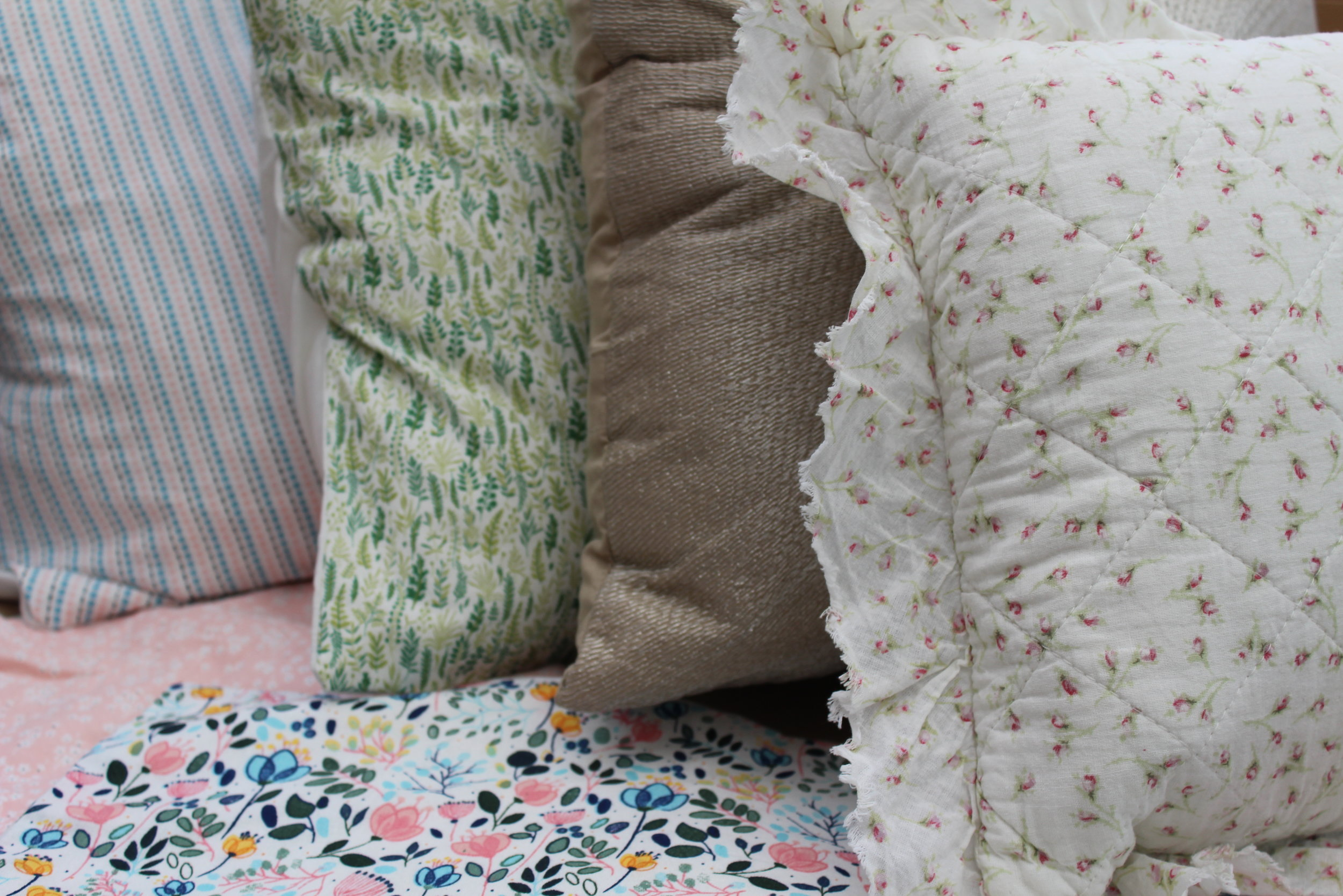 - Assortment of cushions and covers£2 each