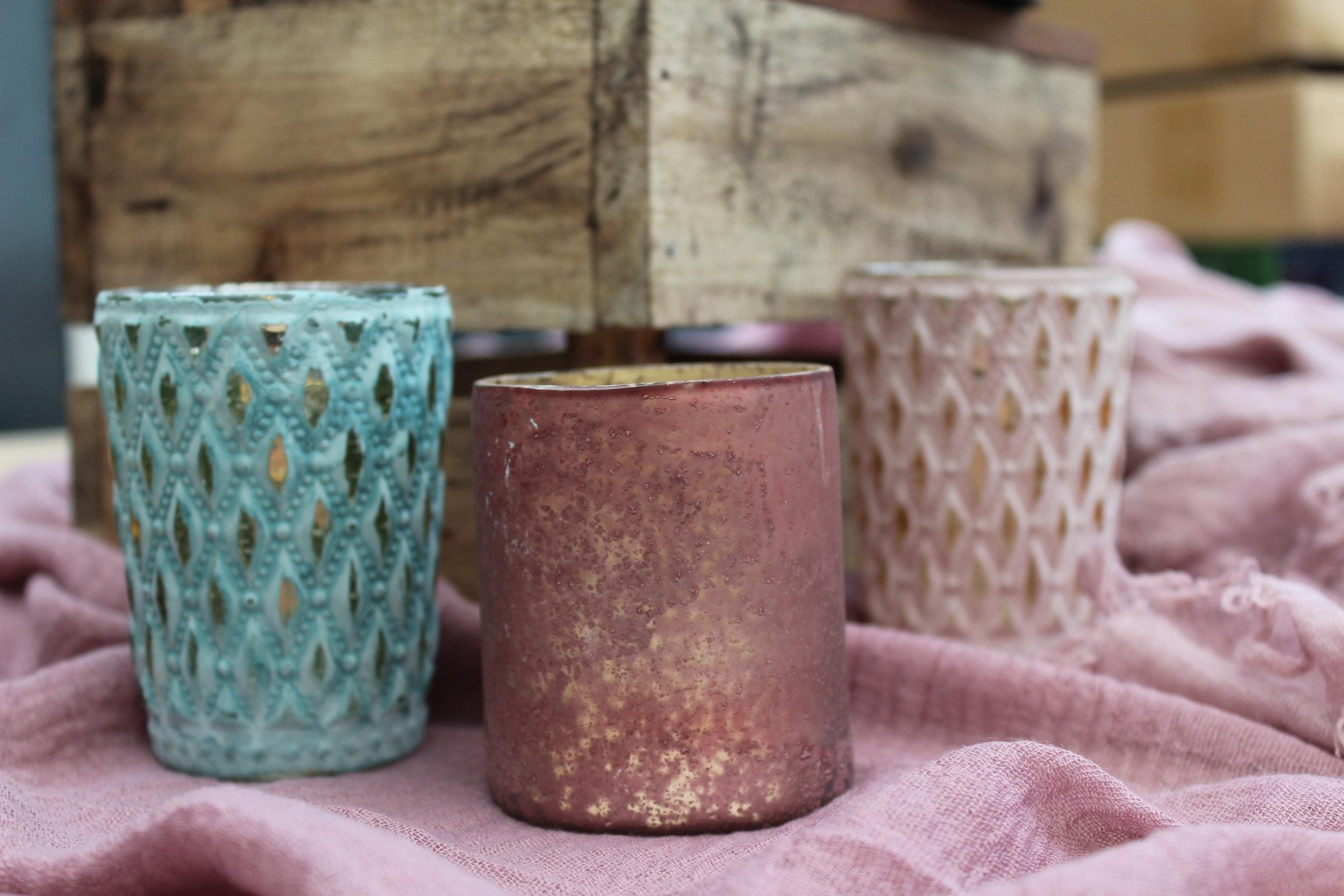 - Various coloured tea light holders£1 each