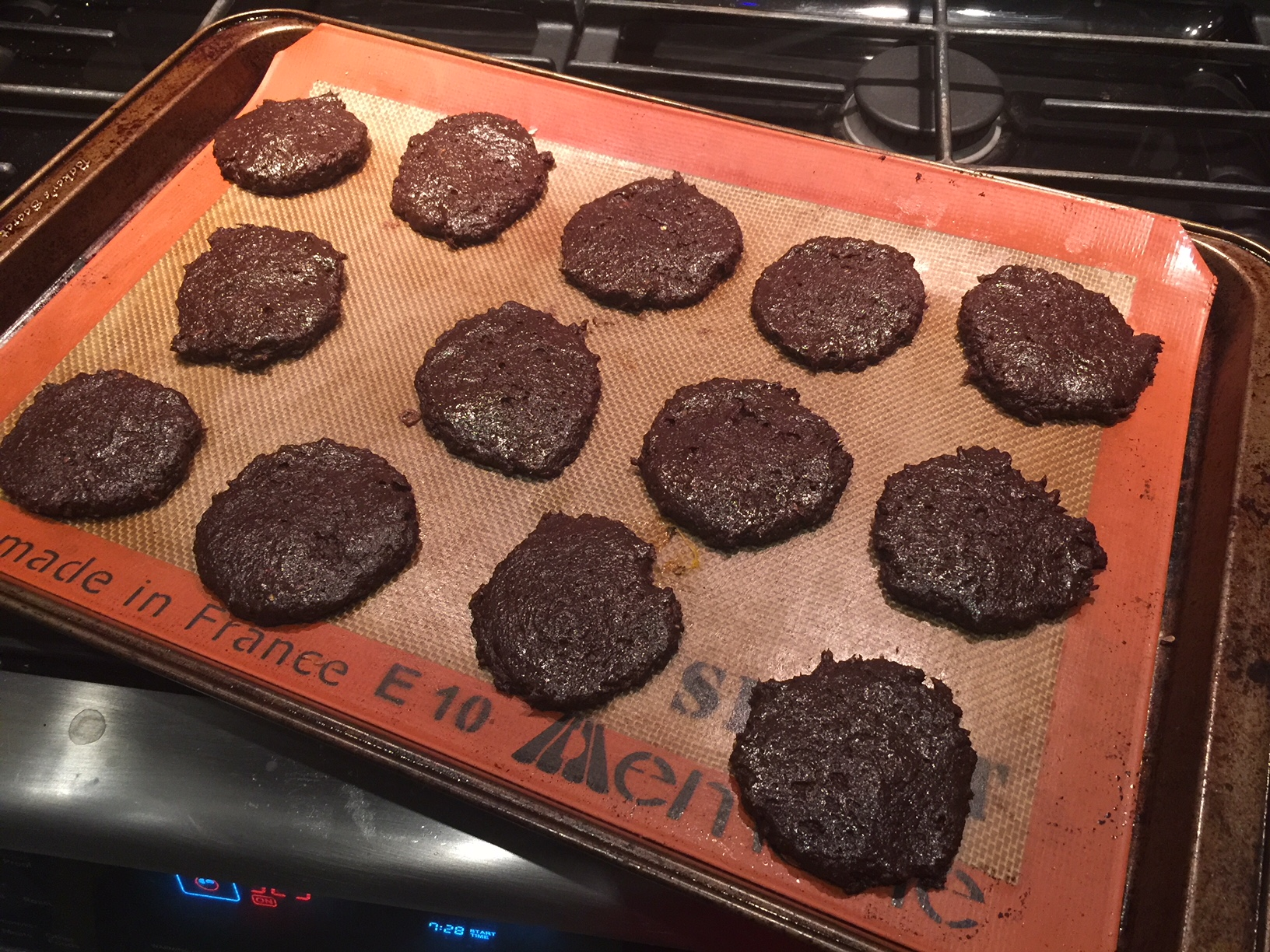 Cookies ready to go in the oven. Hot tip: grease your hands with coconut oil to help shape the cookie dough on the tray.