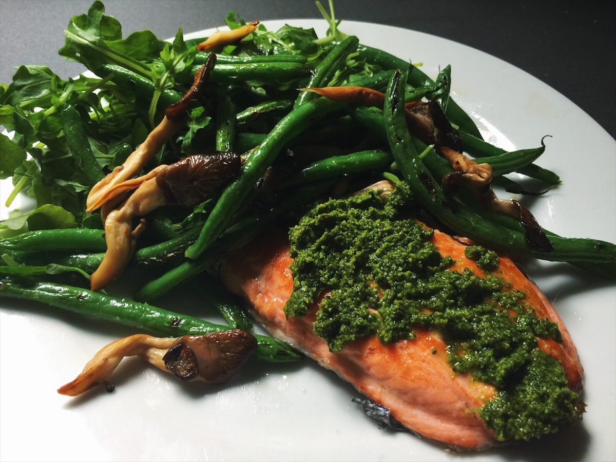 Wild caught salmon smothered in pesto, with pan fried mushrooms, green beans, and arugula. Aka dinner heaven.