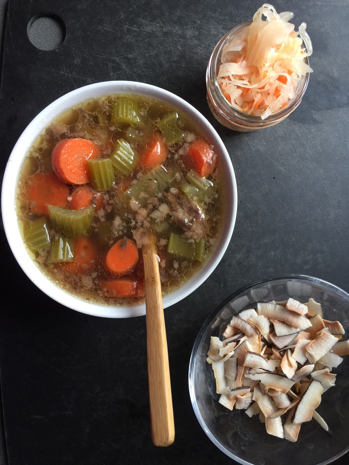 Day 2: Broth soup, ginger-carrot sauerkraut, and toasted coconut.