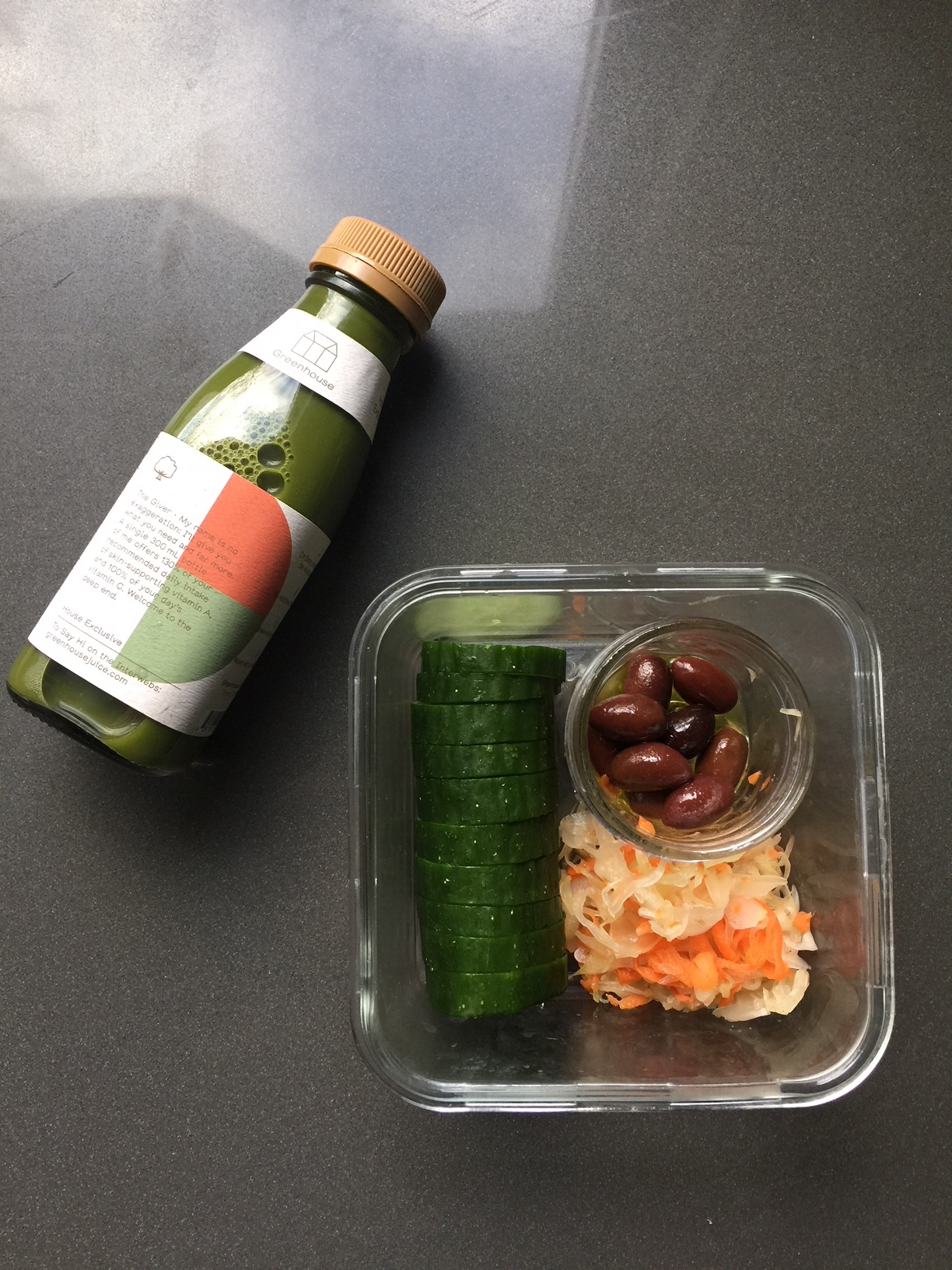 Day 3: Part of lunch- kalamon olives, cucumber, kraut, and a super green juice.