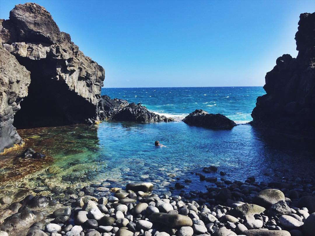 Swimming is ocean rock pools at the end of the Hoapili lava rock trail, on Maui, Hawaii.